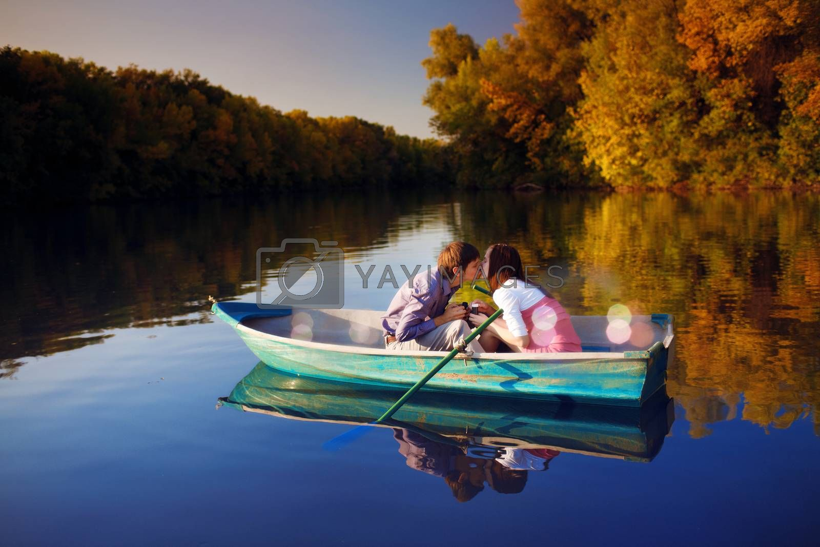 couple in a boat outdoors