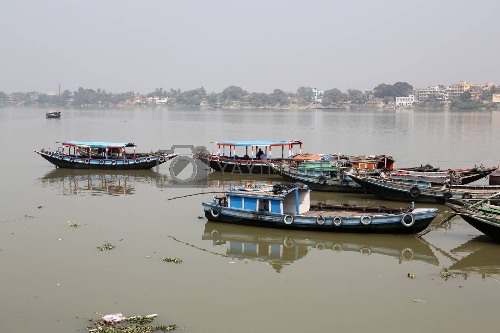 River boats waiting for the passengers at the dock on February 14, 2014. Third biggest indian city, Kolkata is home to approximately 14.1 mill.people