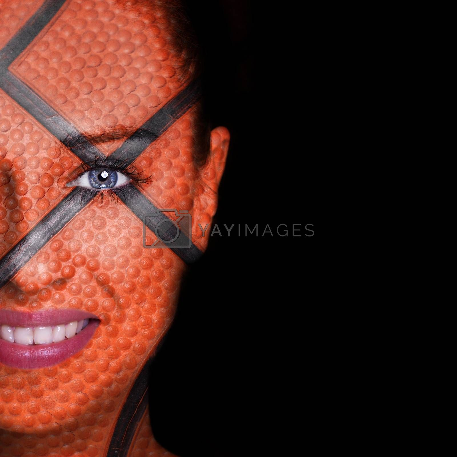 Basketball pattern painted on smiling woman face