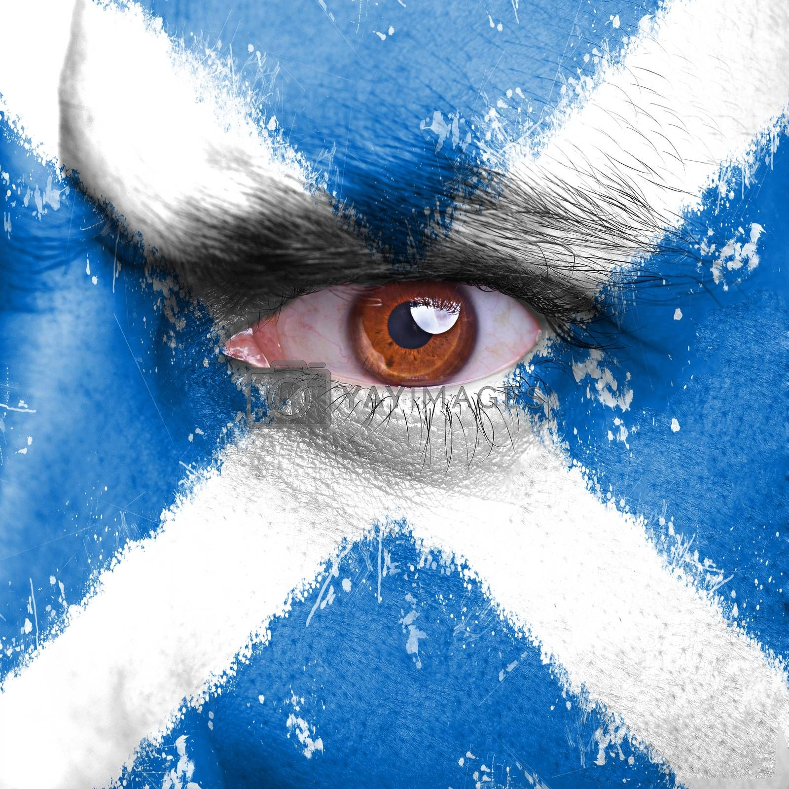 Scotland flag painted on angry man face