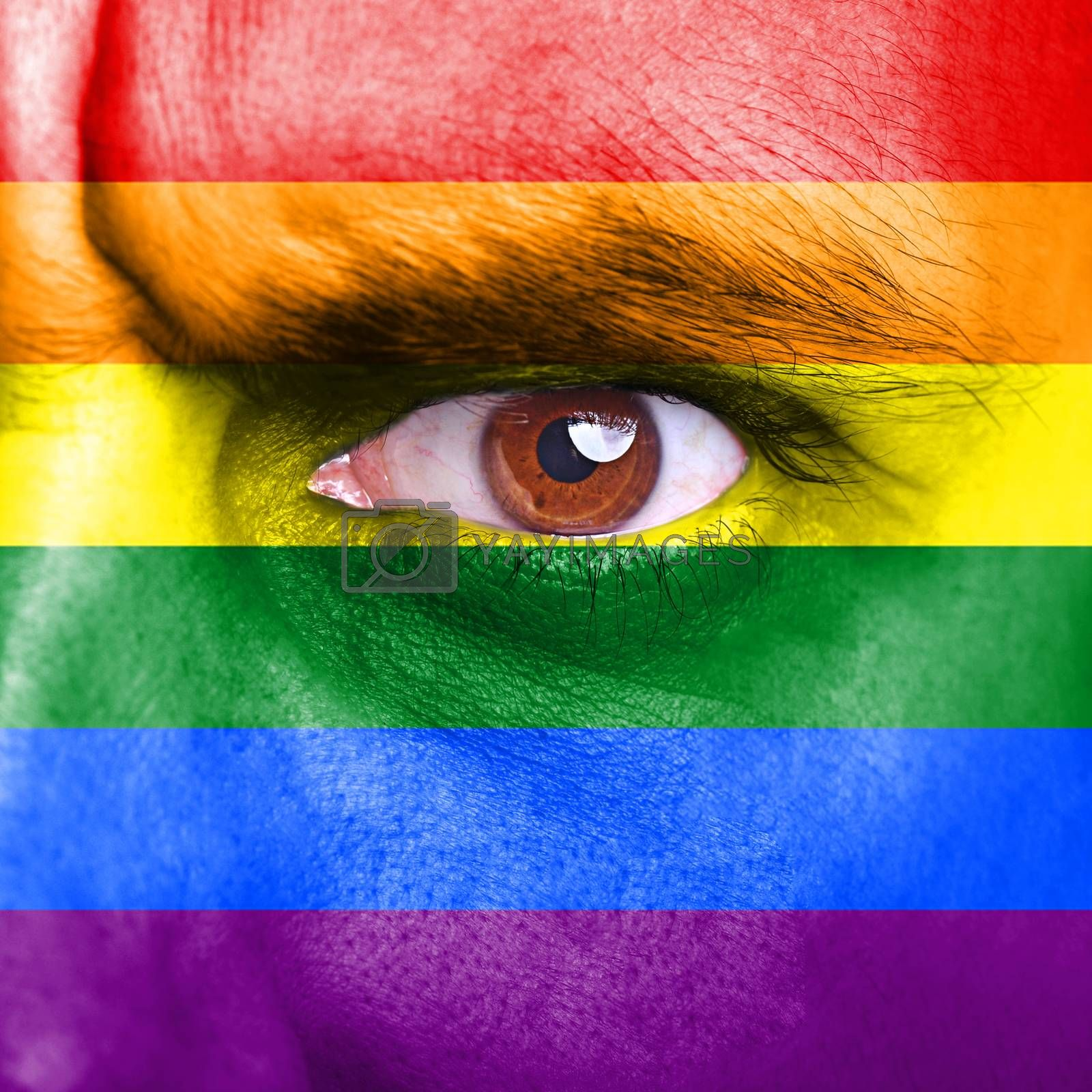 Rainbow flag painted on human face