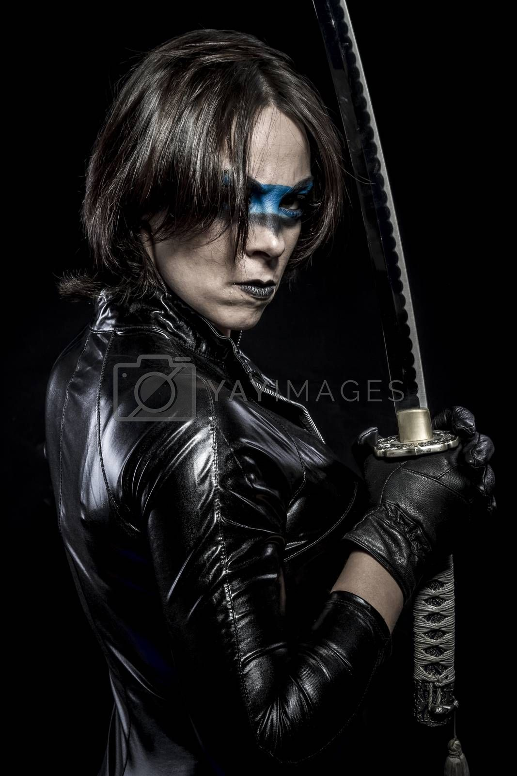 Woman with katana sword in latex costume