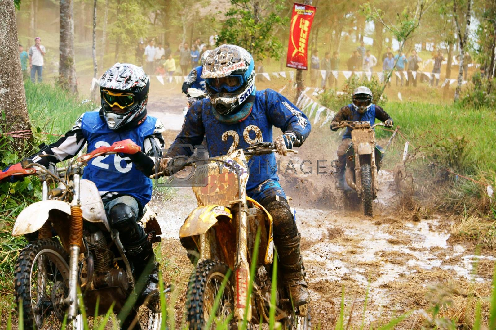 BAO LOC, VIET NAM- DECEMBER 23 Racer in activity at motorcycle race hole on Bao Loc, Viet Nam, they try to across a marshy stretch of road with violent competition in December 23, 2012