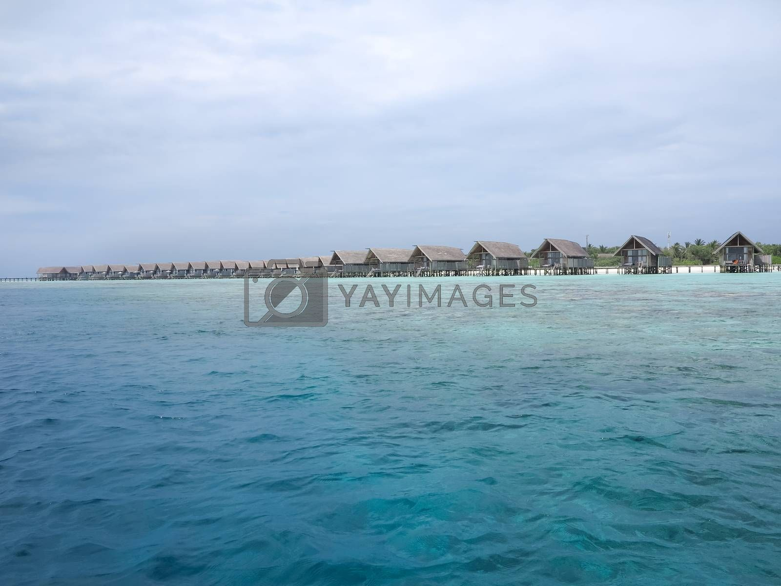 Beautiful view of water villas on island