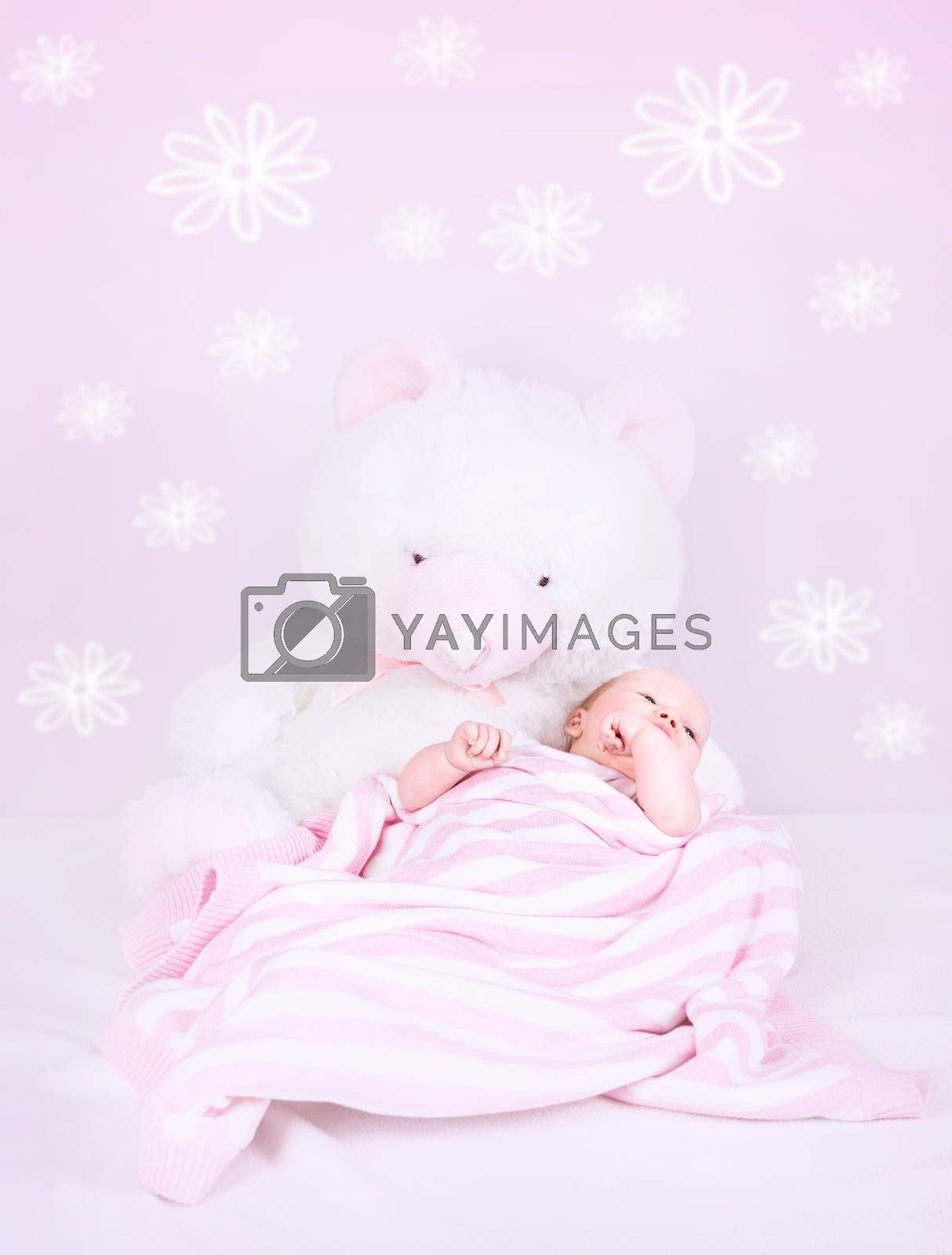 Sweet baby sleep in own pink bedroom with great white teddy bear, cute interior for child with flower print on the wall, happy childhood concept