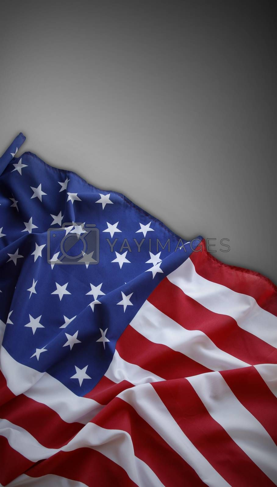 Closeup of American flag on plain background. Copy space