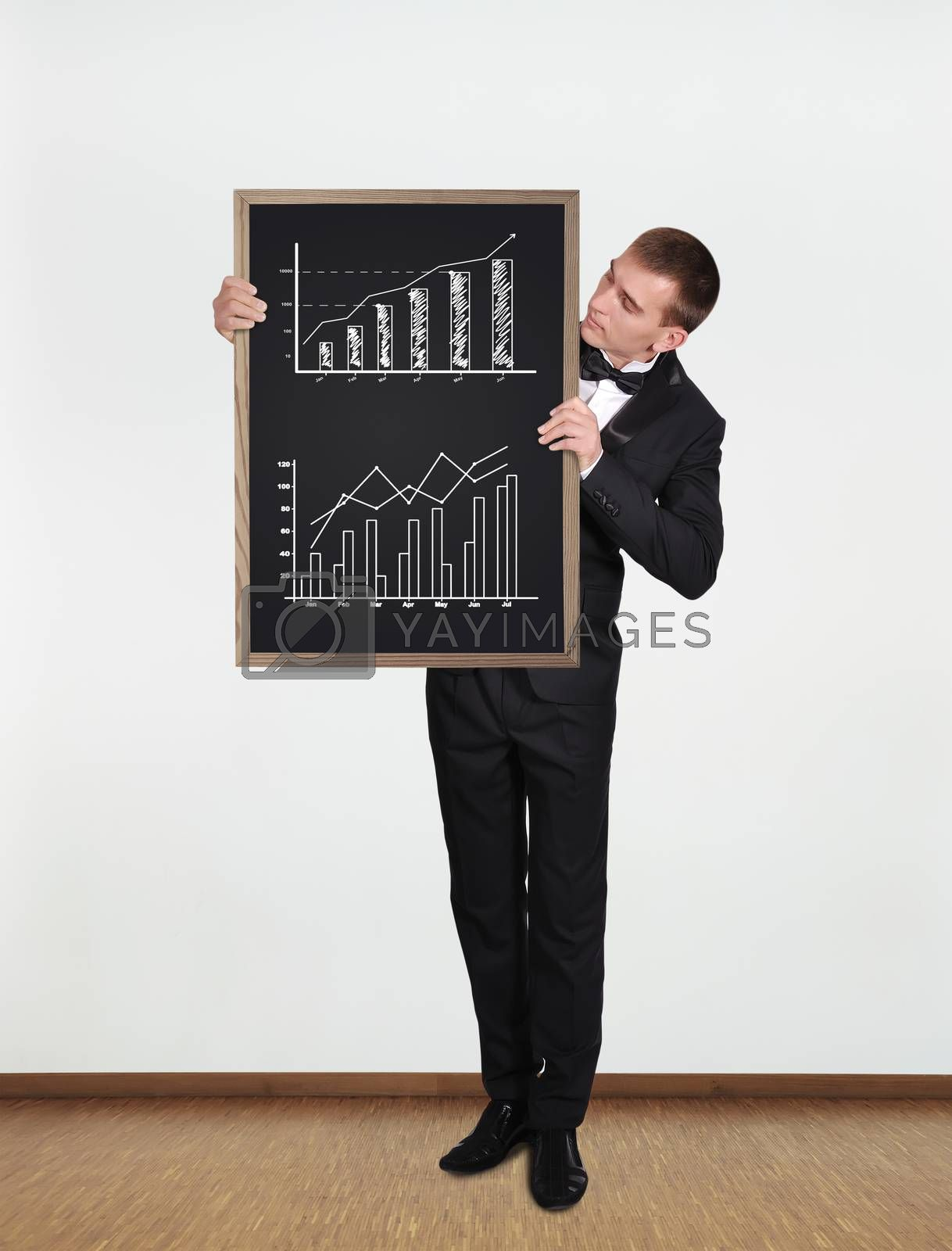 businessman standing in office and  holding blackboard with diagram