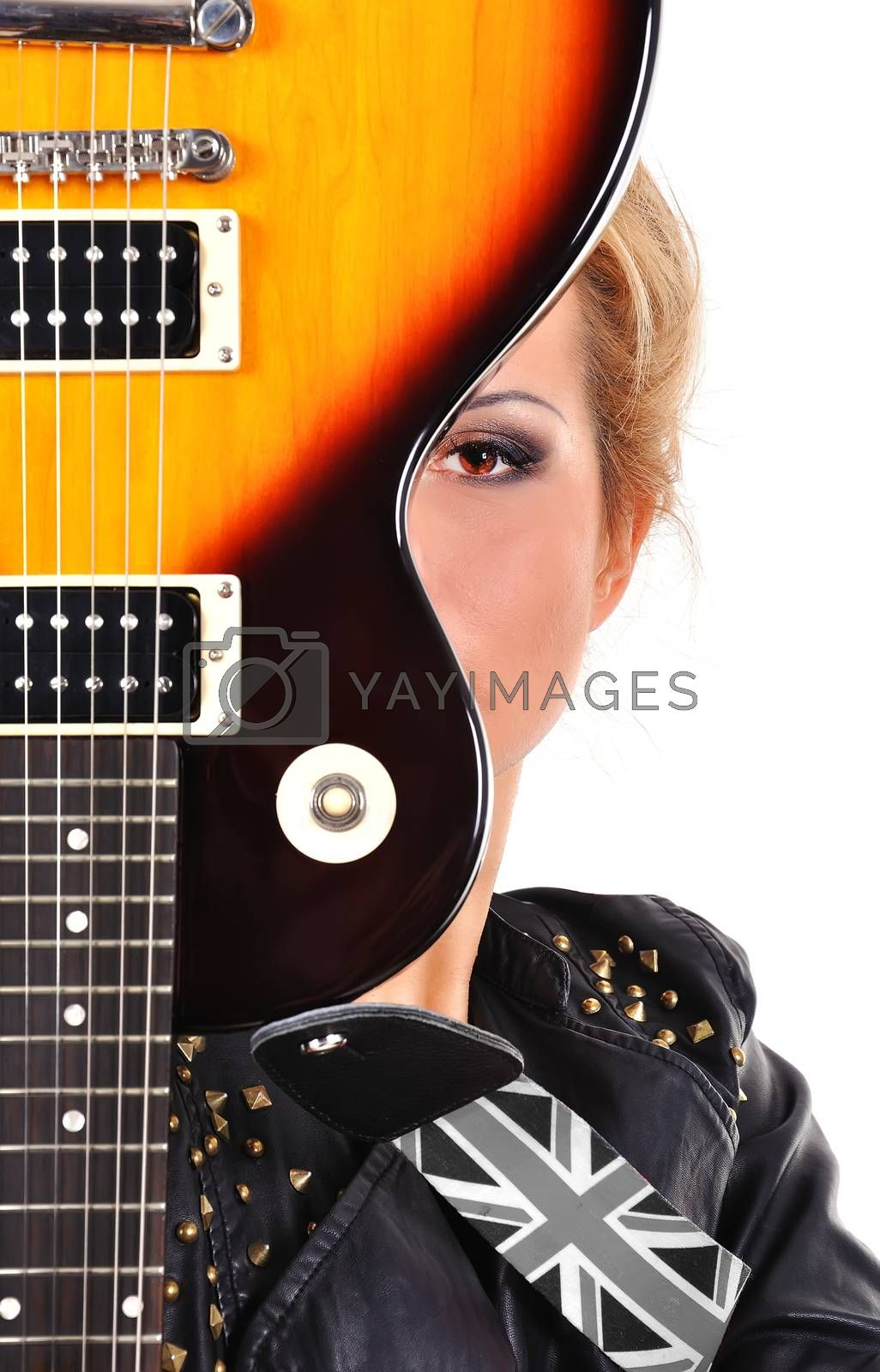 rock star girl looking on  electric guitar