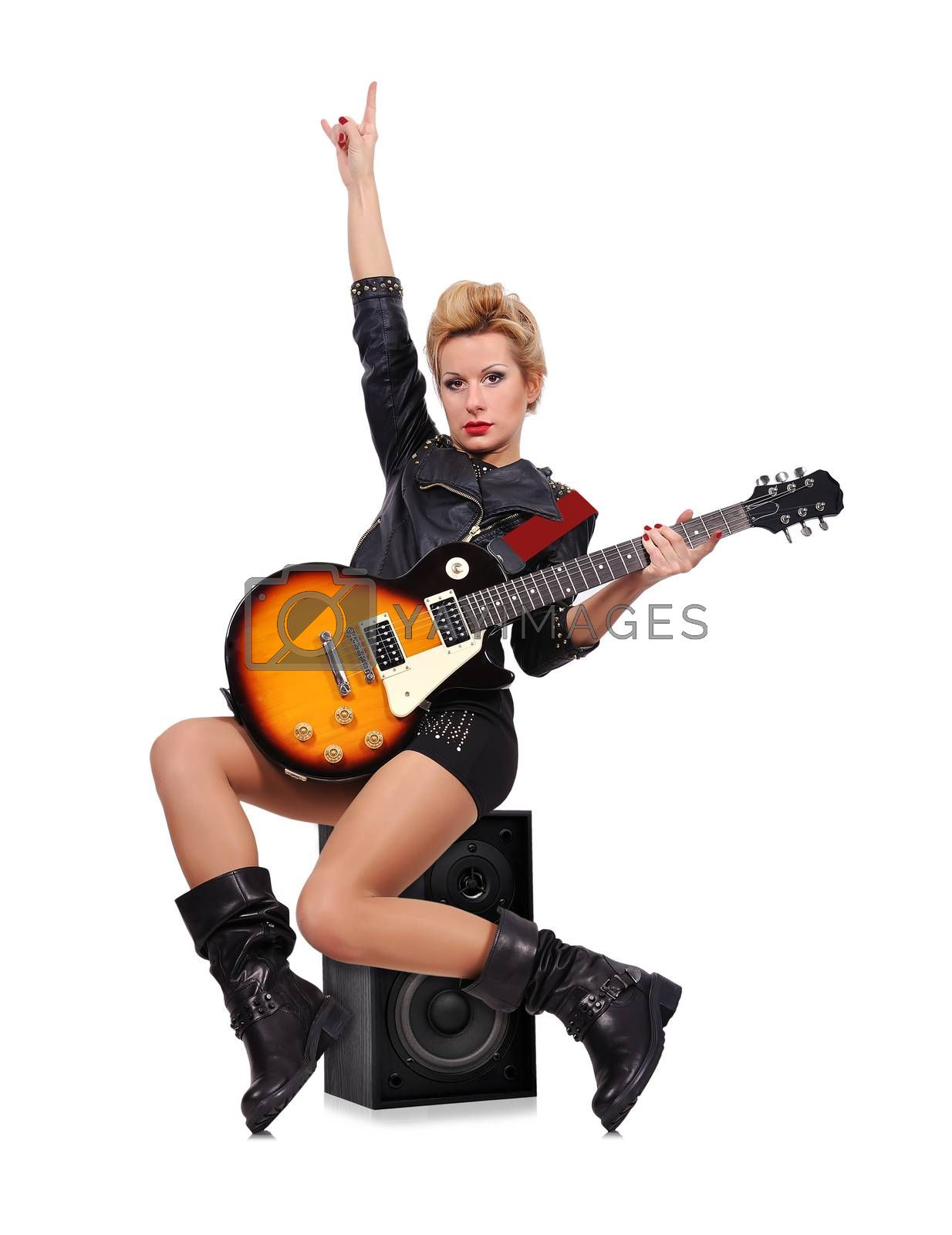 rock girl sitting on speaker and playing on electric guitar