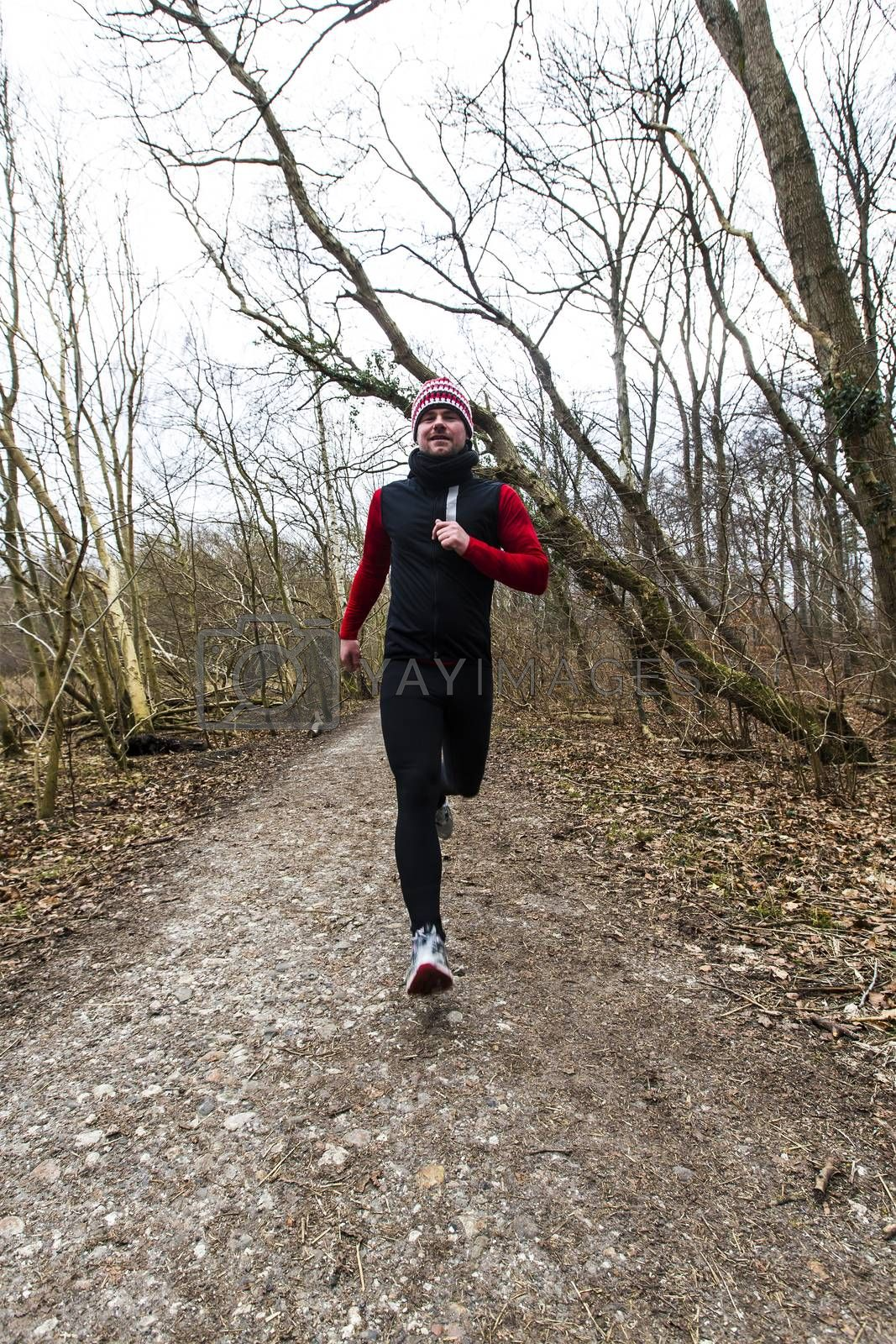A man running outdoors in a forest