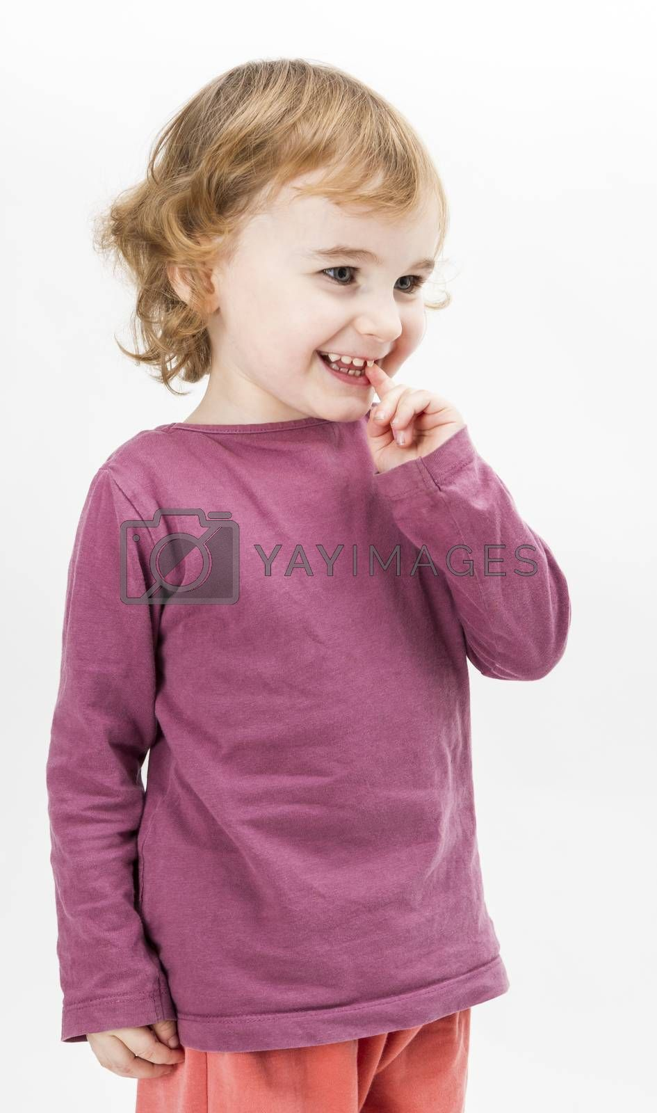 abashed caucasian girl looking to side. vertical image in light grey background