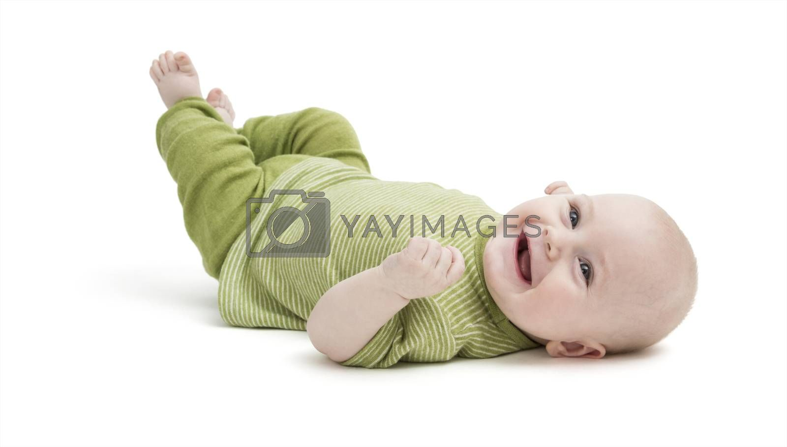 happy baby in green clothing lying on his back. isolated on white background