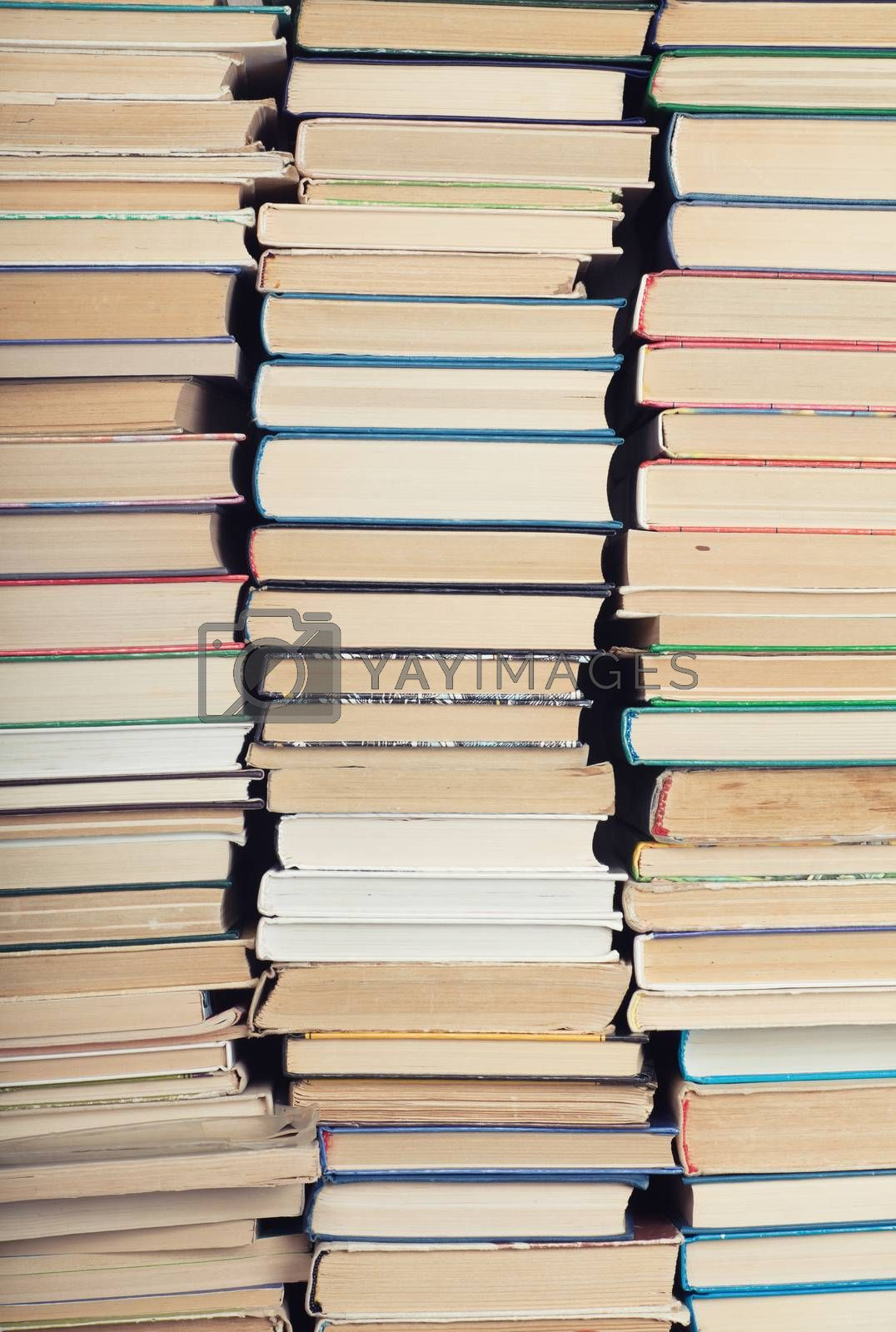 Rear view of three stacks of books