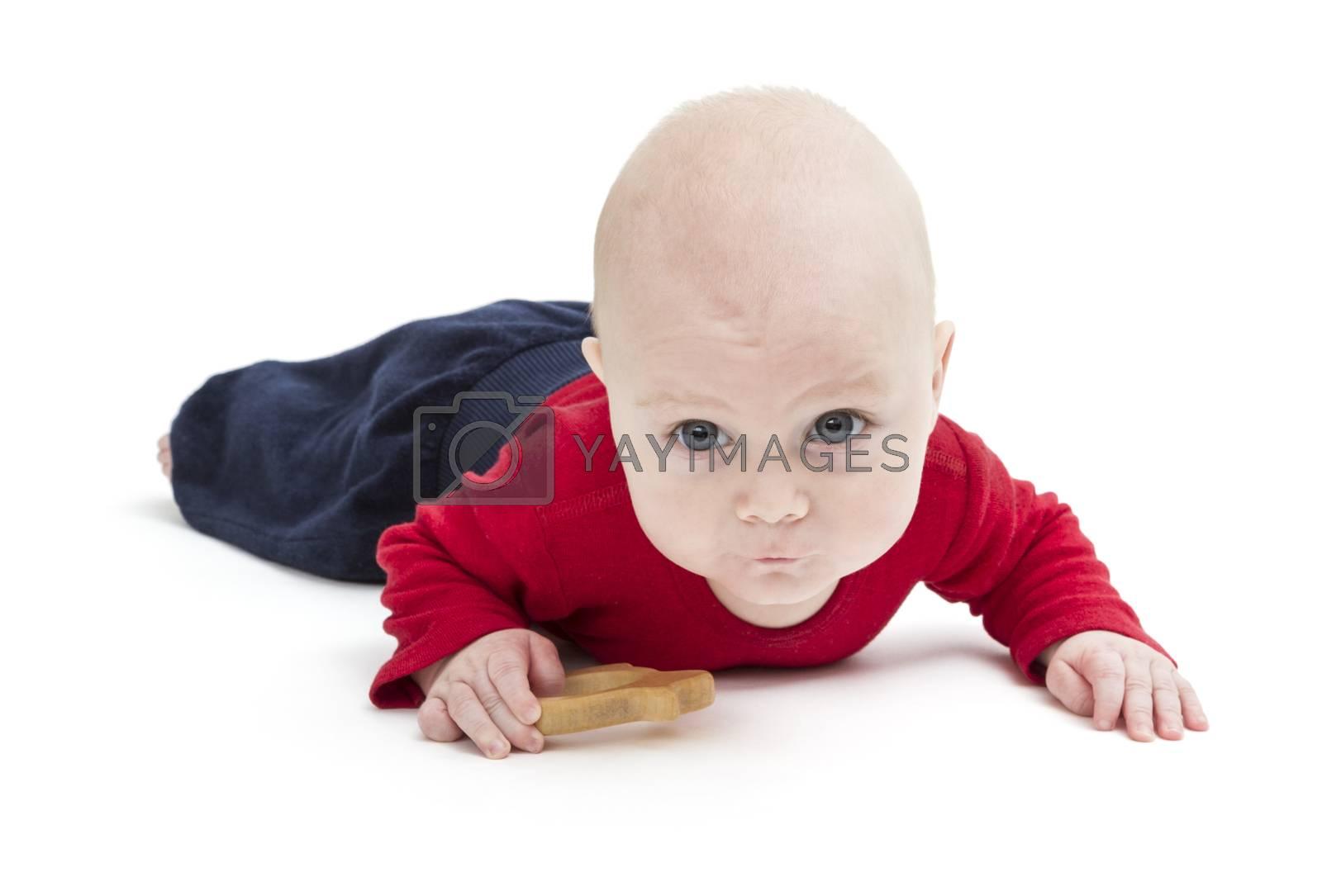 baby crawling on floor. horizontal image isolated on white
