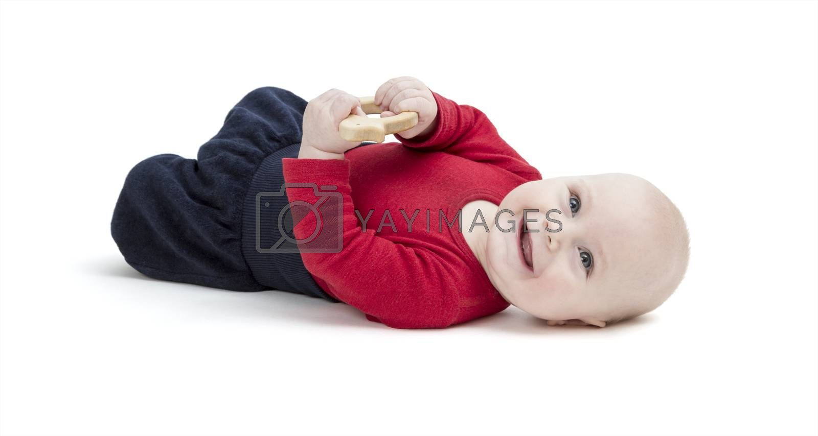 happy baby in red shirt on floor. isolated on white background. studio shot