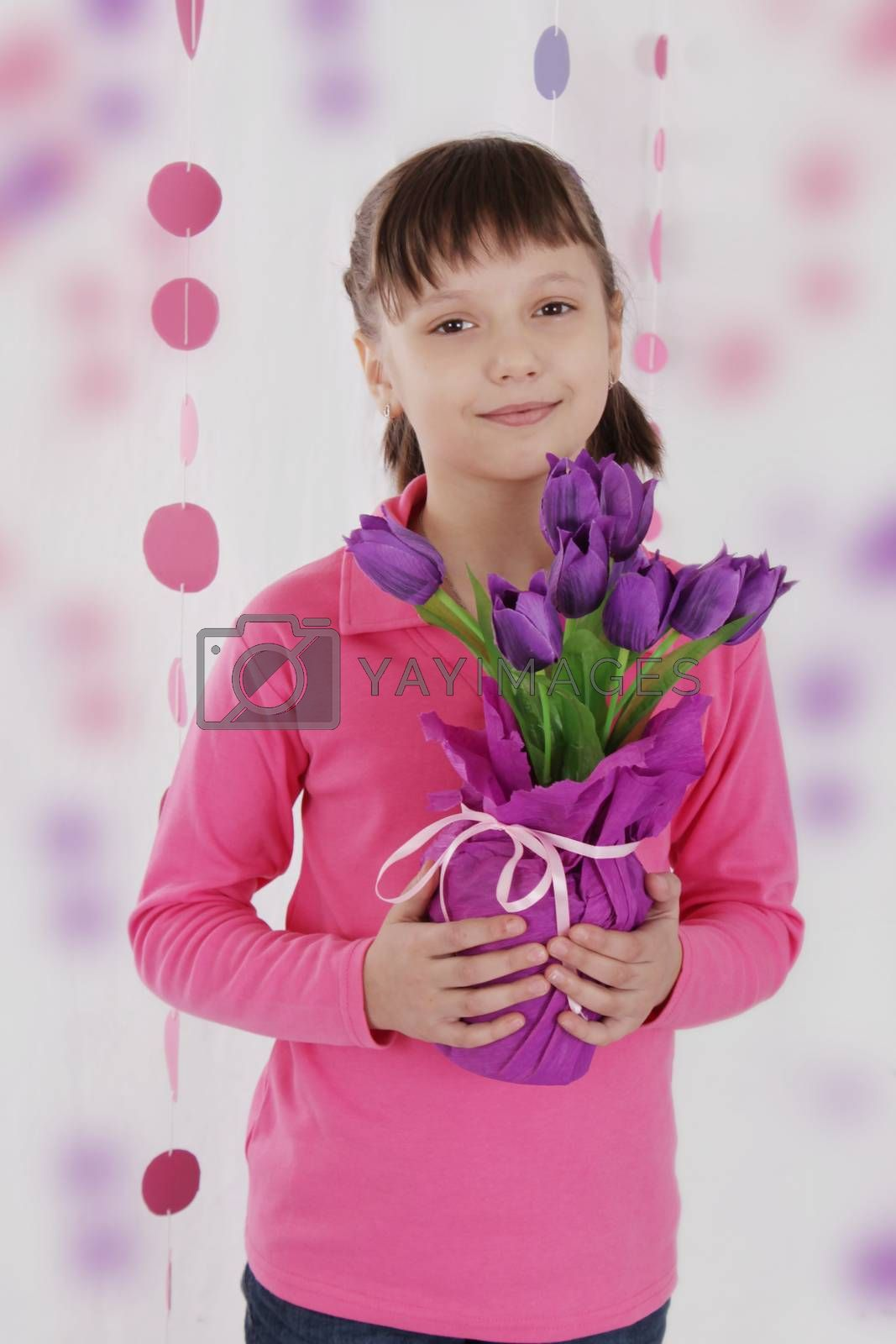 Cute girl with violet tulip bouquet in pink decocation