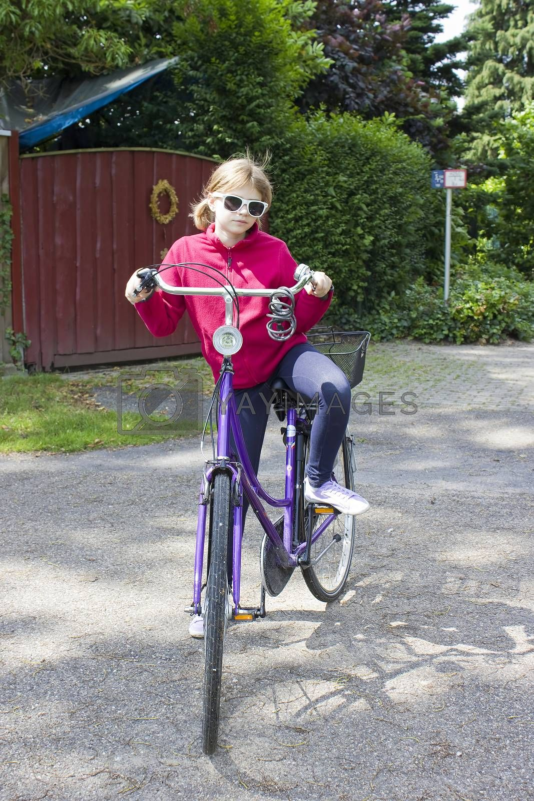 young girl with her bicycle