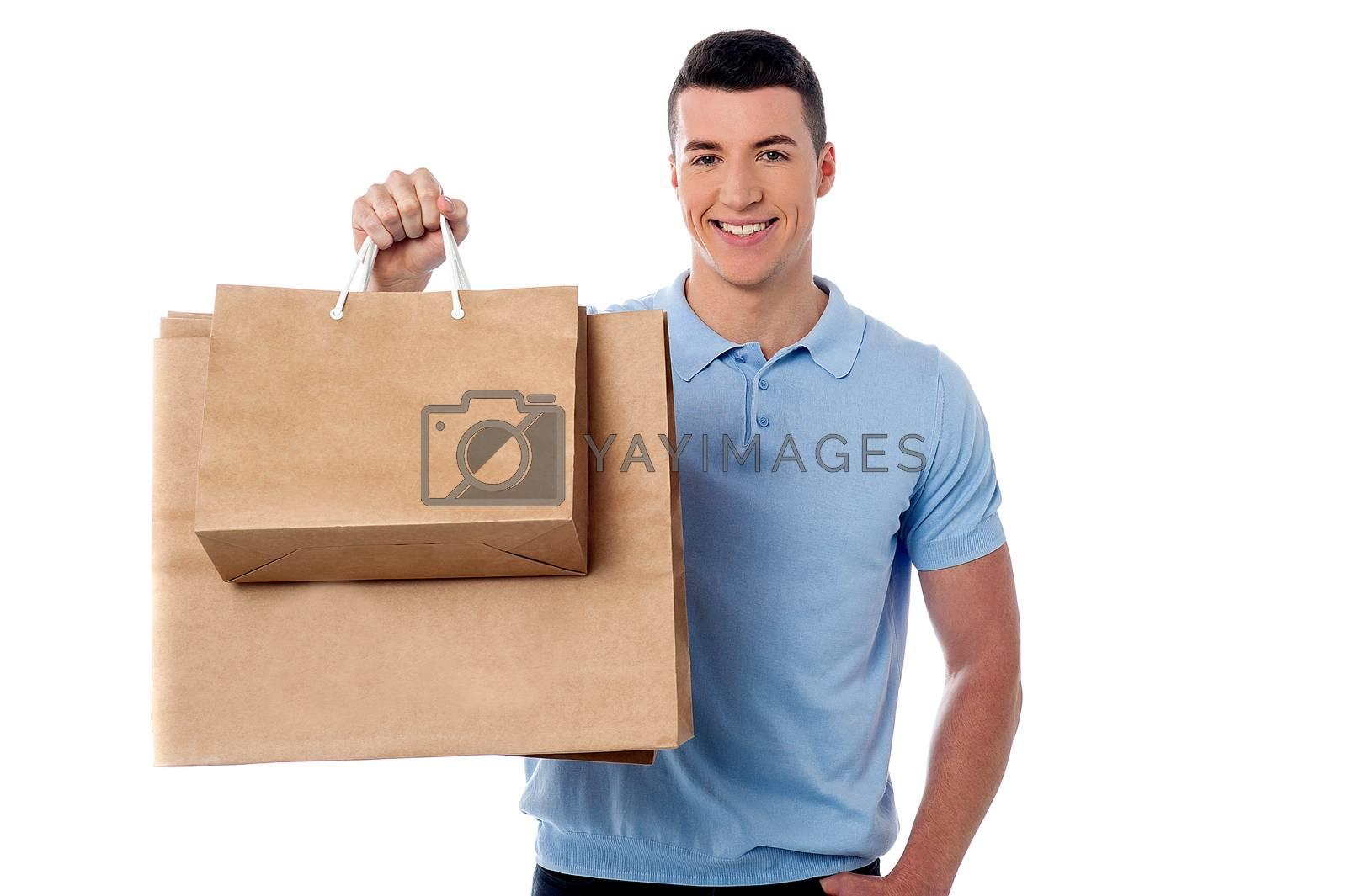 Young man showing his shopping bag