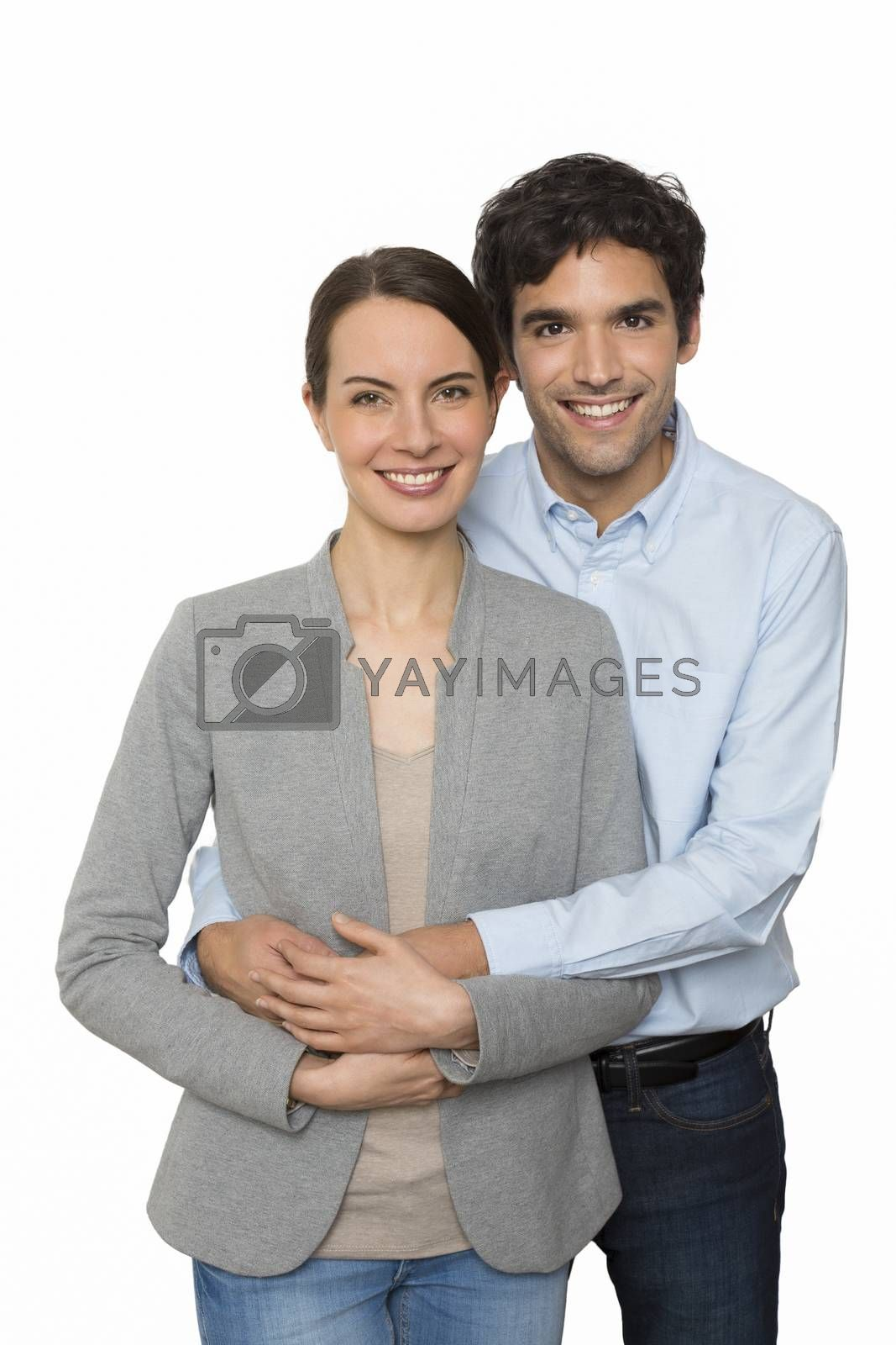 Happy  young lover couple standing on white background, isolated by LDProd