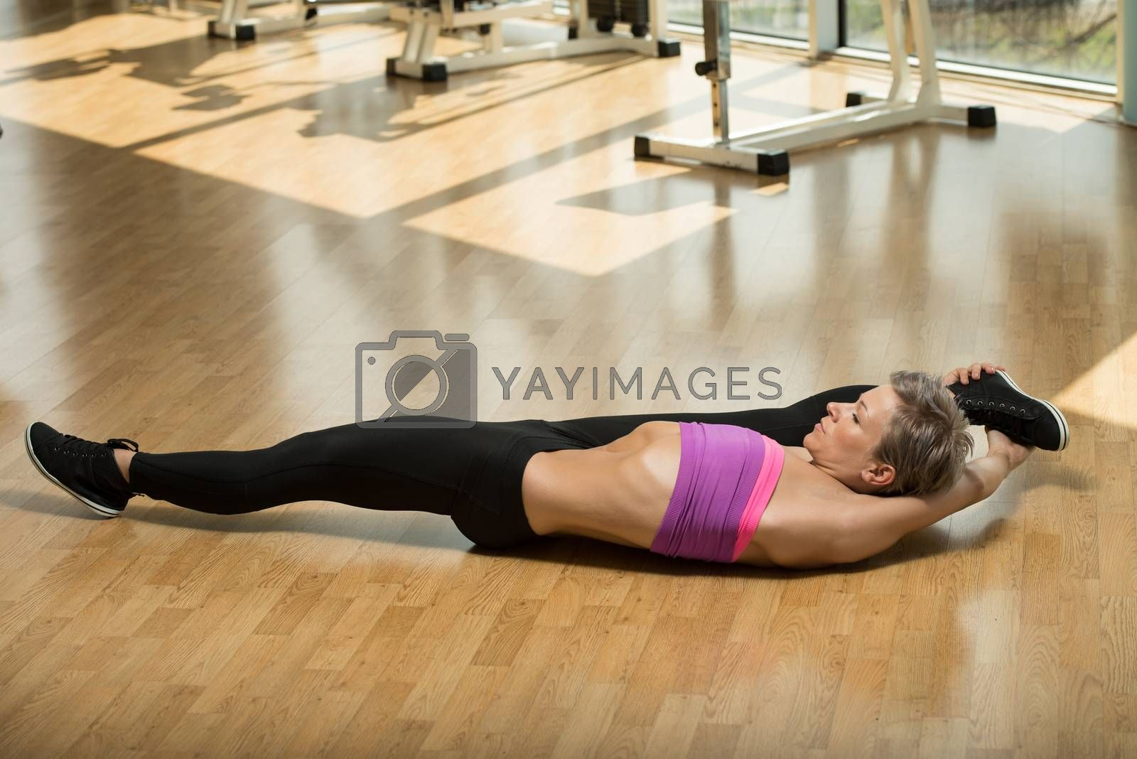 Royalty free image of Fitness Woman Stretching On The Floor by JalePhoto
