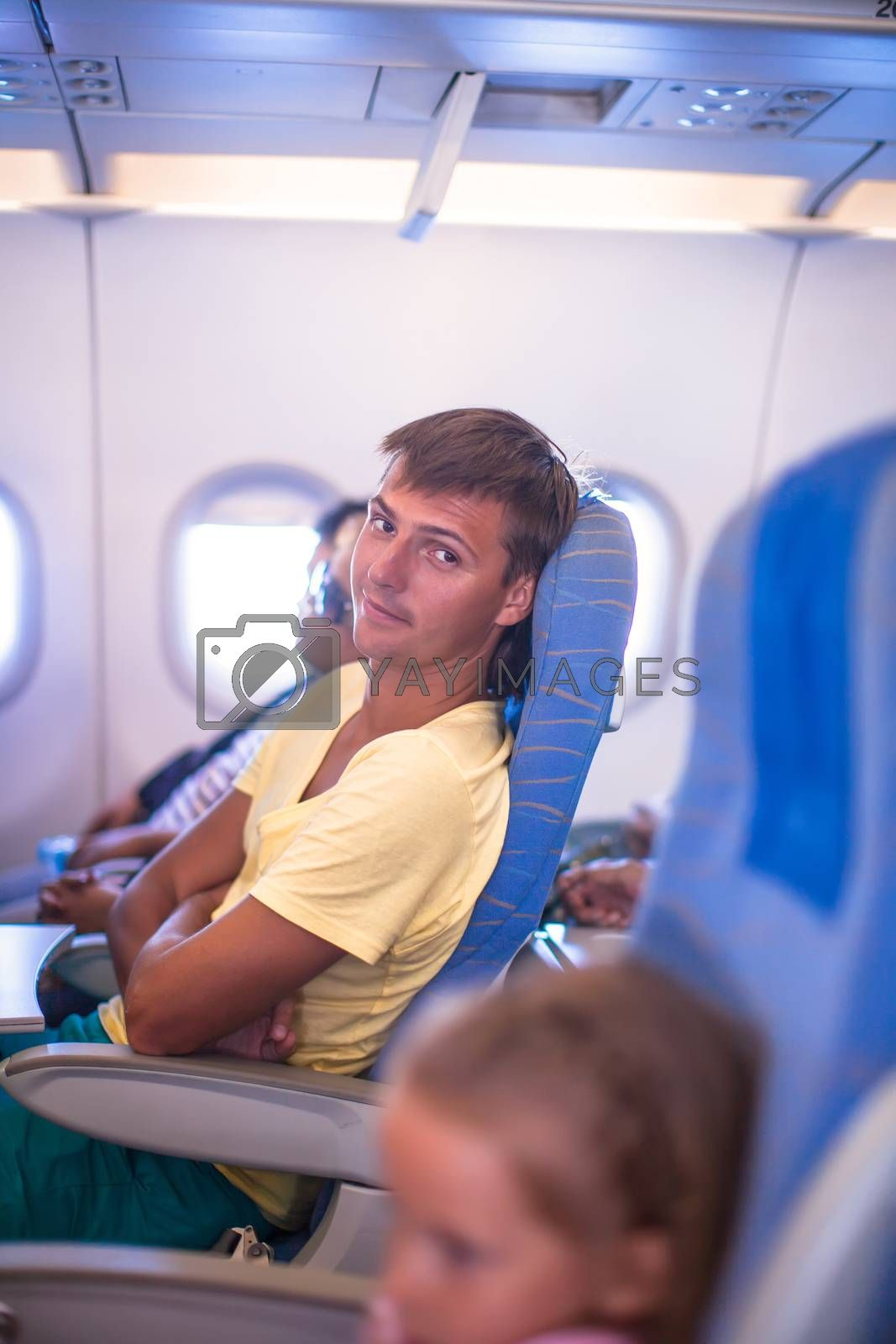 Young man in an airplane during flight