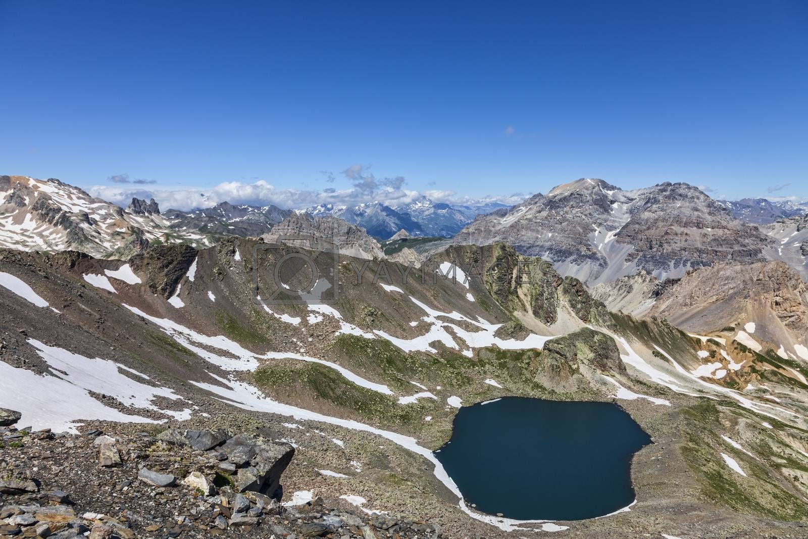 Image of the Lac Blanc (White Lake) located at 2699 m on Vallee de la Claree (Claree Valley) in Hautes Alpes department in France. The place is located in one of the wildest hiking trail in the high French Alps.