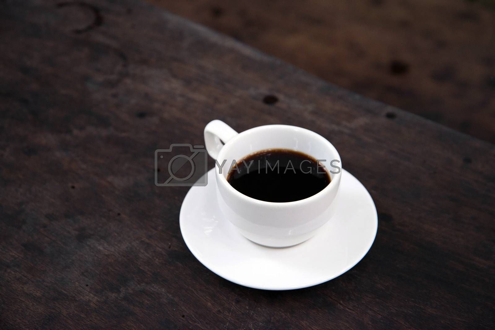 White Coffee Cup on a Wooden Table  by jakgree