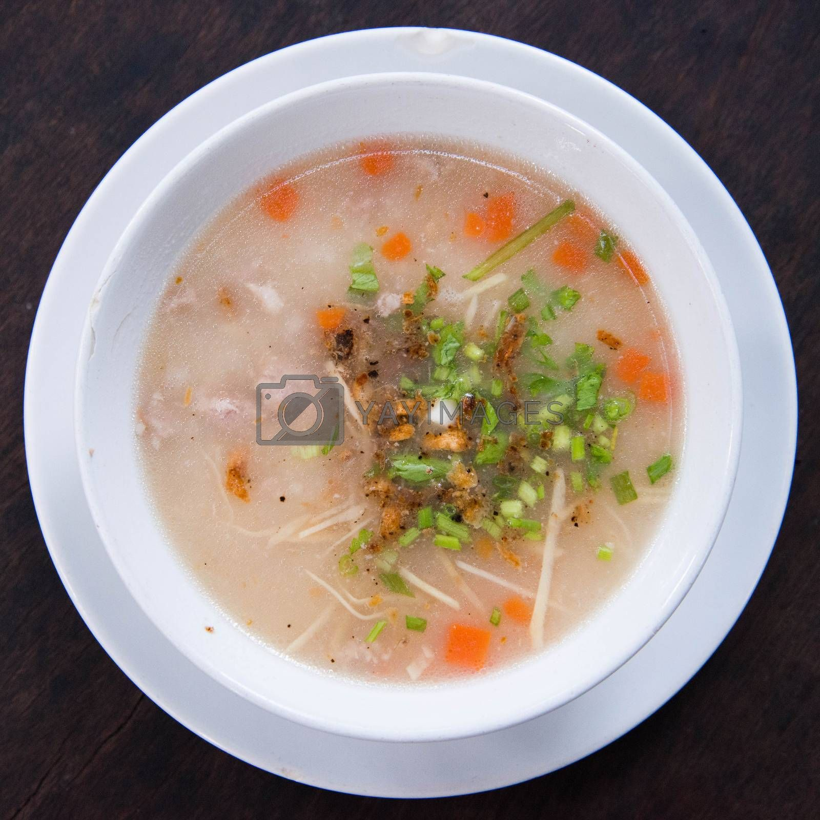 Traditional thai porridge rice gruel in bowl, con gee  by jakgree