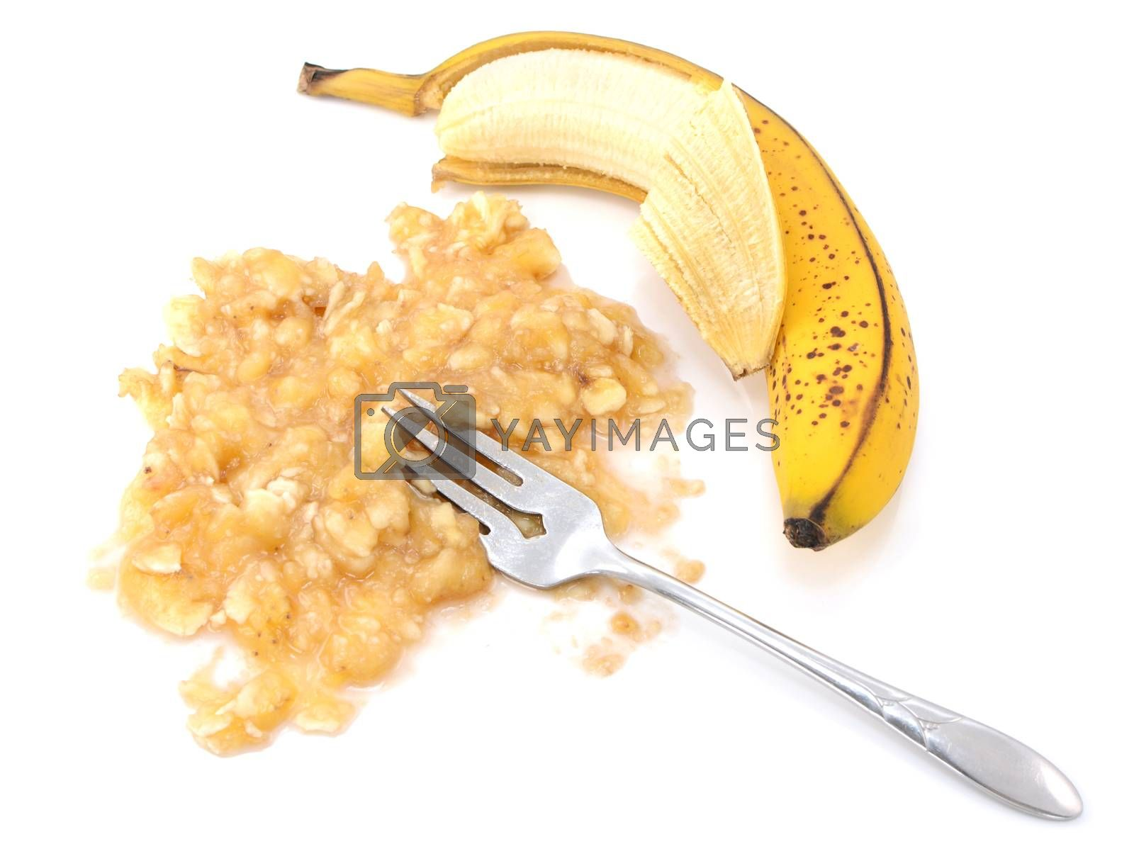 Half-peeled ripe banana with mashed fruit by sarahdoow