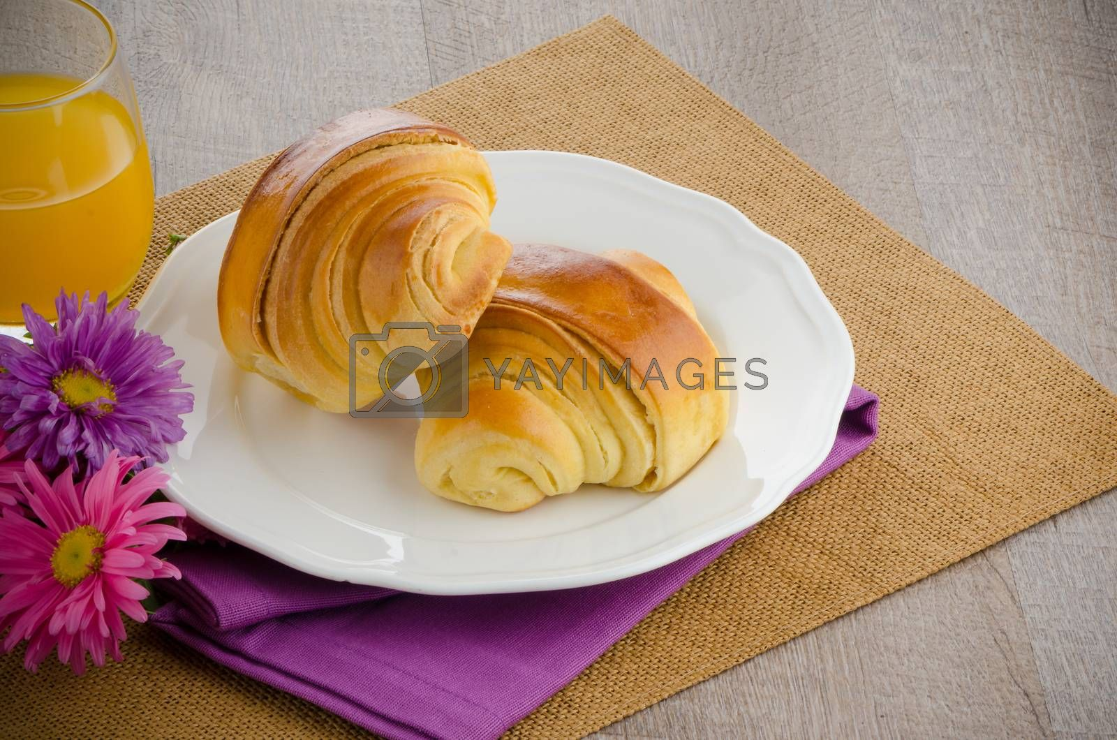 Croissants with orange juice  by homydesign