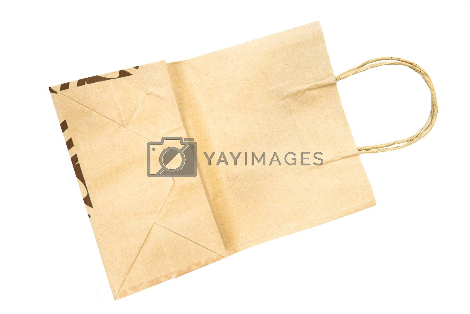 Brown paper bag isolated on white background by jakgree
