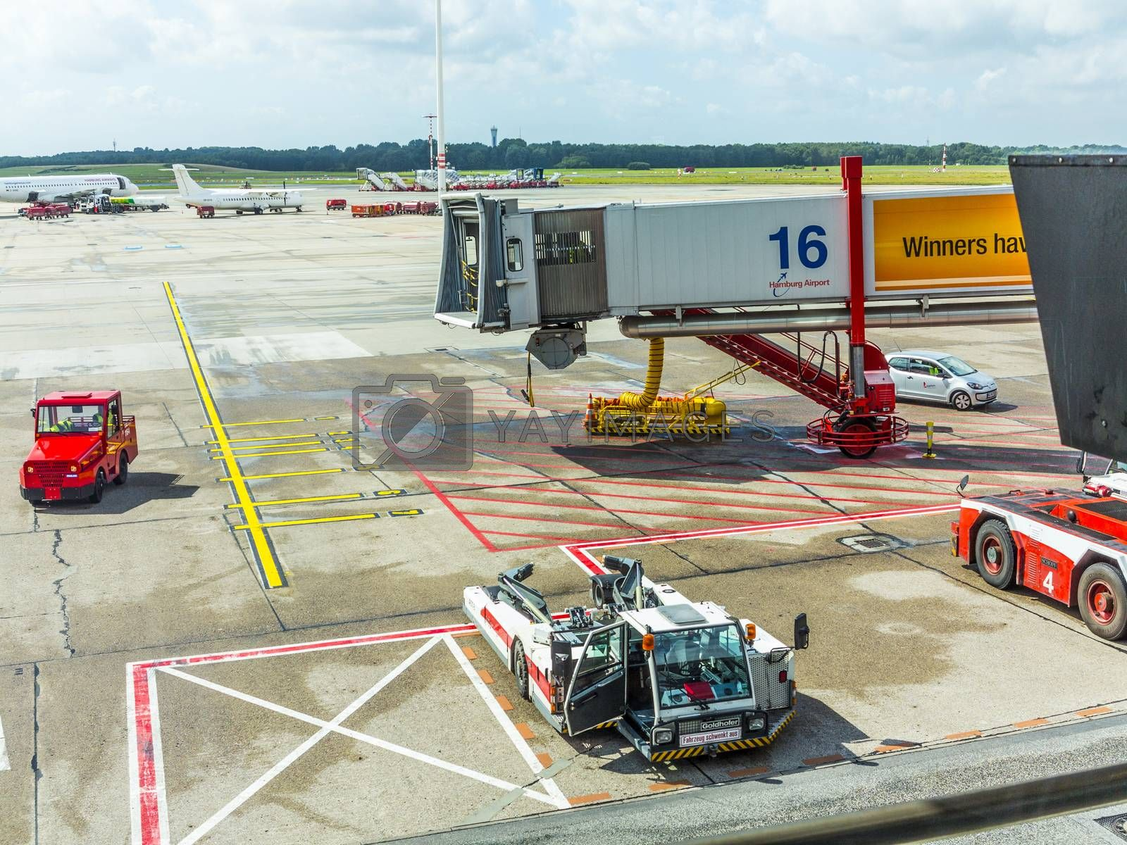 HAMBURG, GERMANY - AUGUST 16: Aircraft at the gate in Terminal 2 on August 16, 2012 in Hamburg, Germany. Terminal 2 was completed in 1993 and houses Lufthansa and other Star Alliance partners.