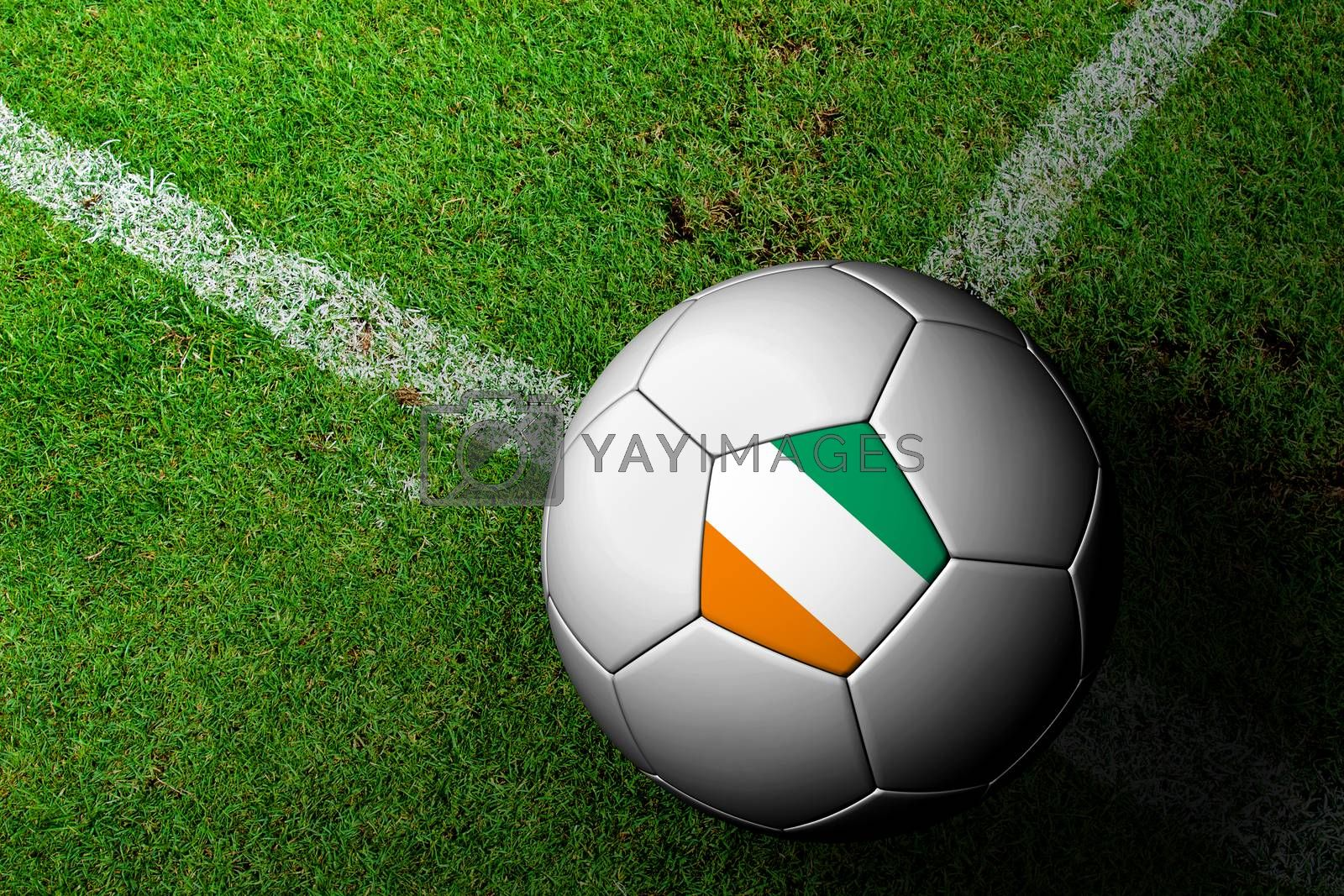 Royalty free image of Ivory Coast Flag Pattern of a soccer ball in green grass by jakgree