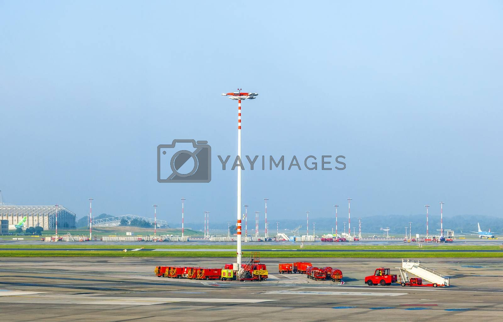HAMBURG, GERMANY - SEP 3: communication and light mast at apron of Hamburg Airport on September 3, 2012 in Hamburg, Germany.  It is the fifth-busiest German airport with 13 mio pax in 2011.