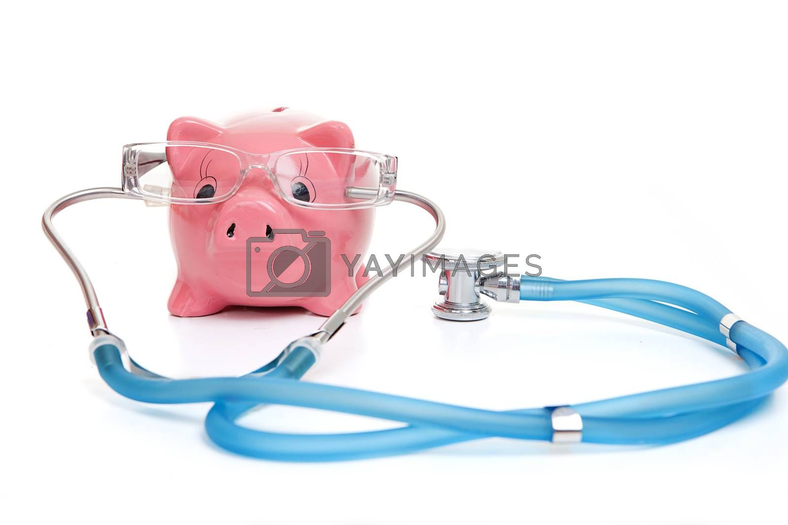 medical insurance concept with stephoscope money and glasses