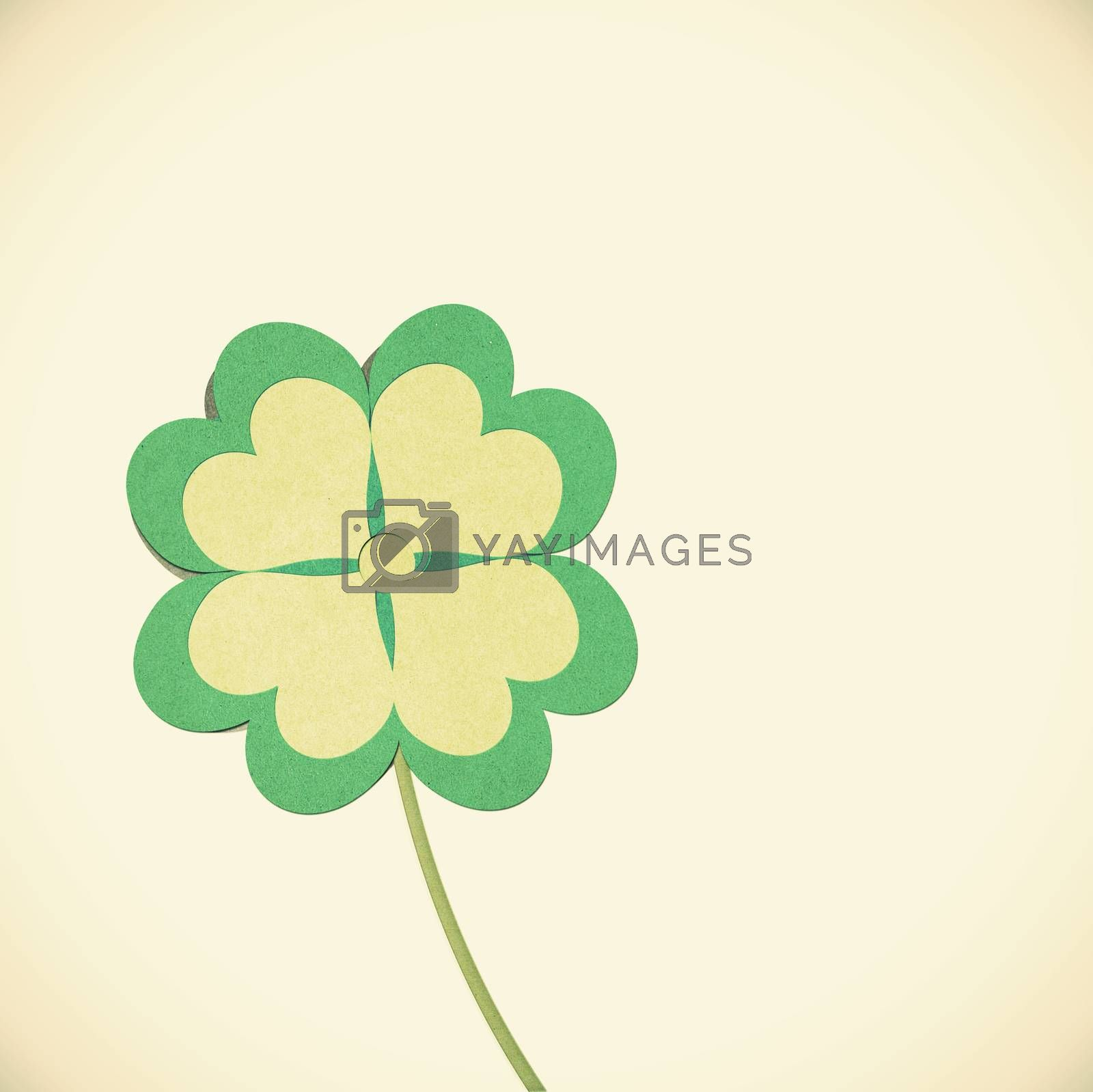 Old Paper texture clover with four leaves on vintage tone  backg by jakgree