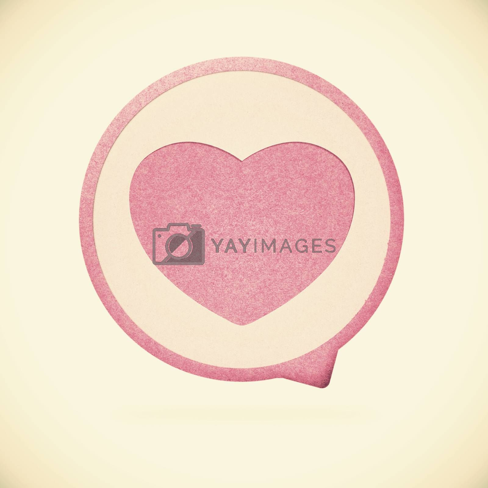 Heart tag recycled paper on vintage tone  background by jakgree