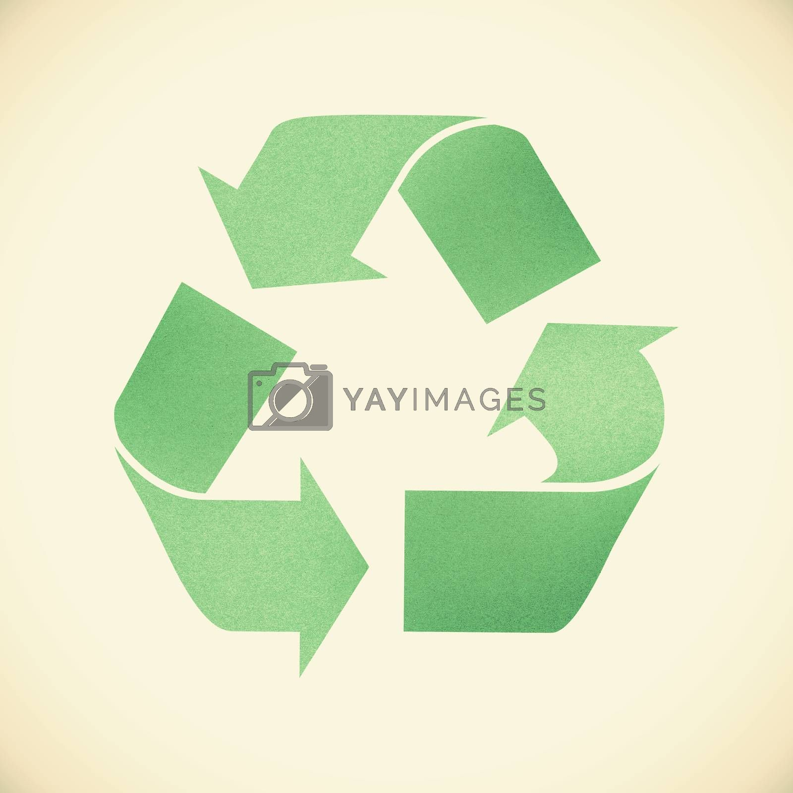 Green recycle sign recycled paper on vintage tone  background by jakgree