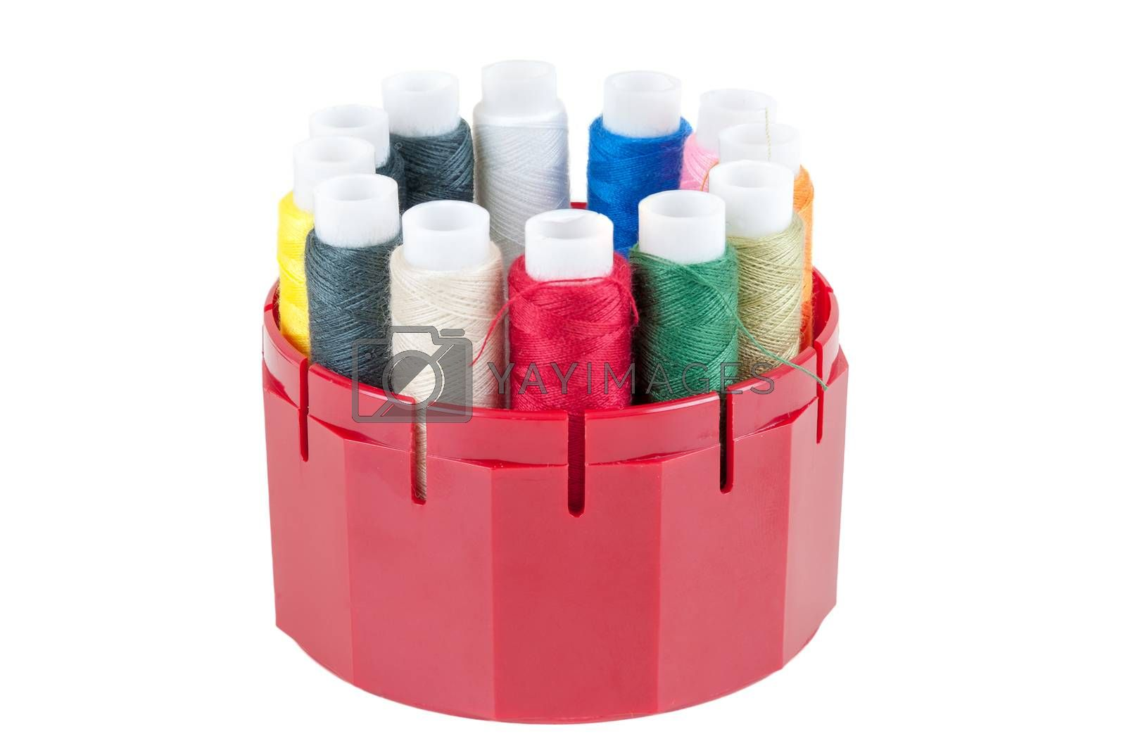 Colored threads in a box on white background by mkos83