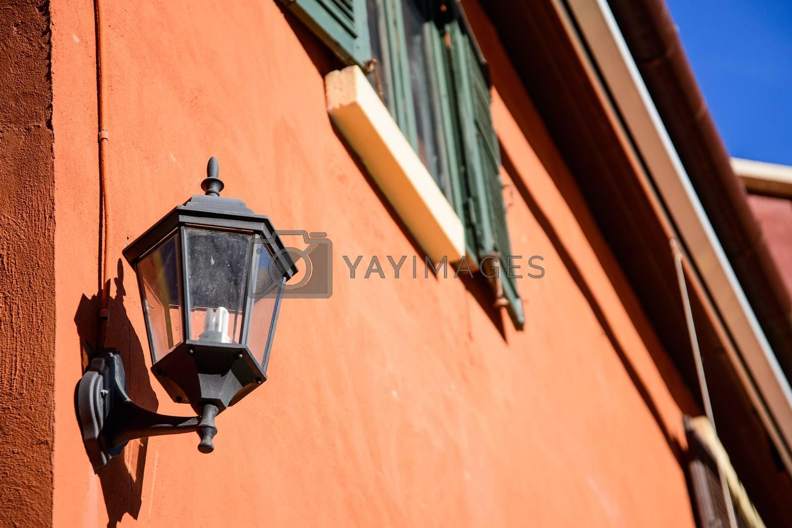 old-fashion lamp hanging on brick wall by jakgree