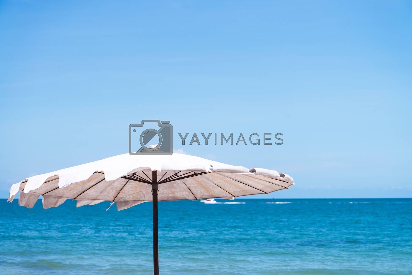 umbrella on sand beach.  by jakgree