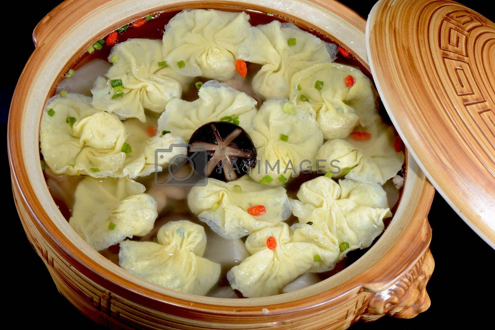 Chinese Food:Boiled dumplings in a pot by bbbar