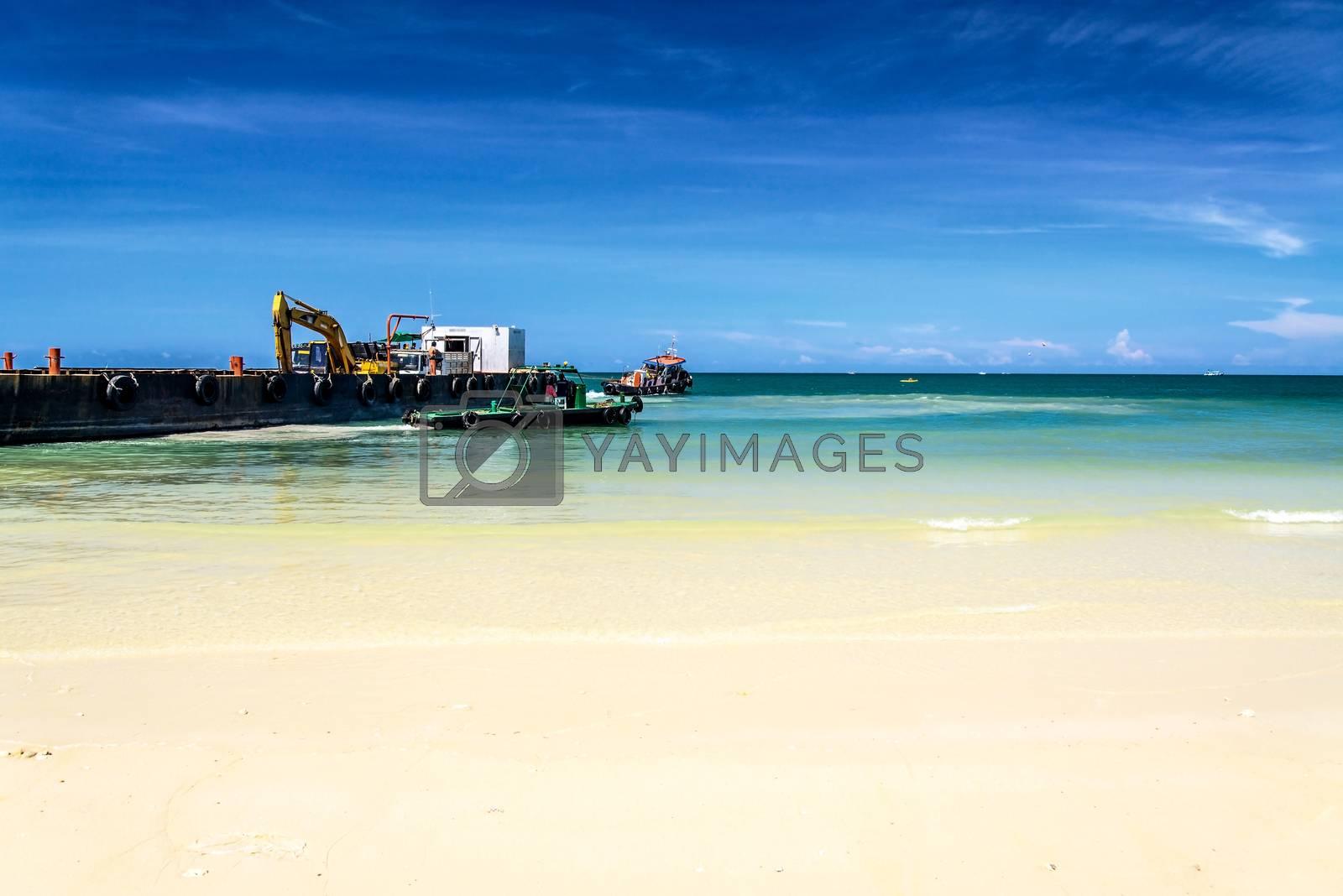 bulldozer working on a beach by jakgree