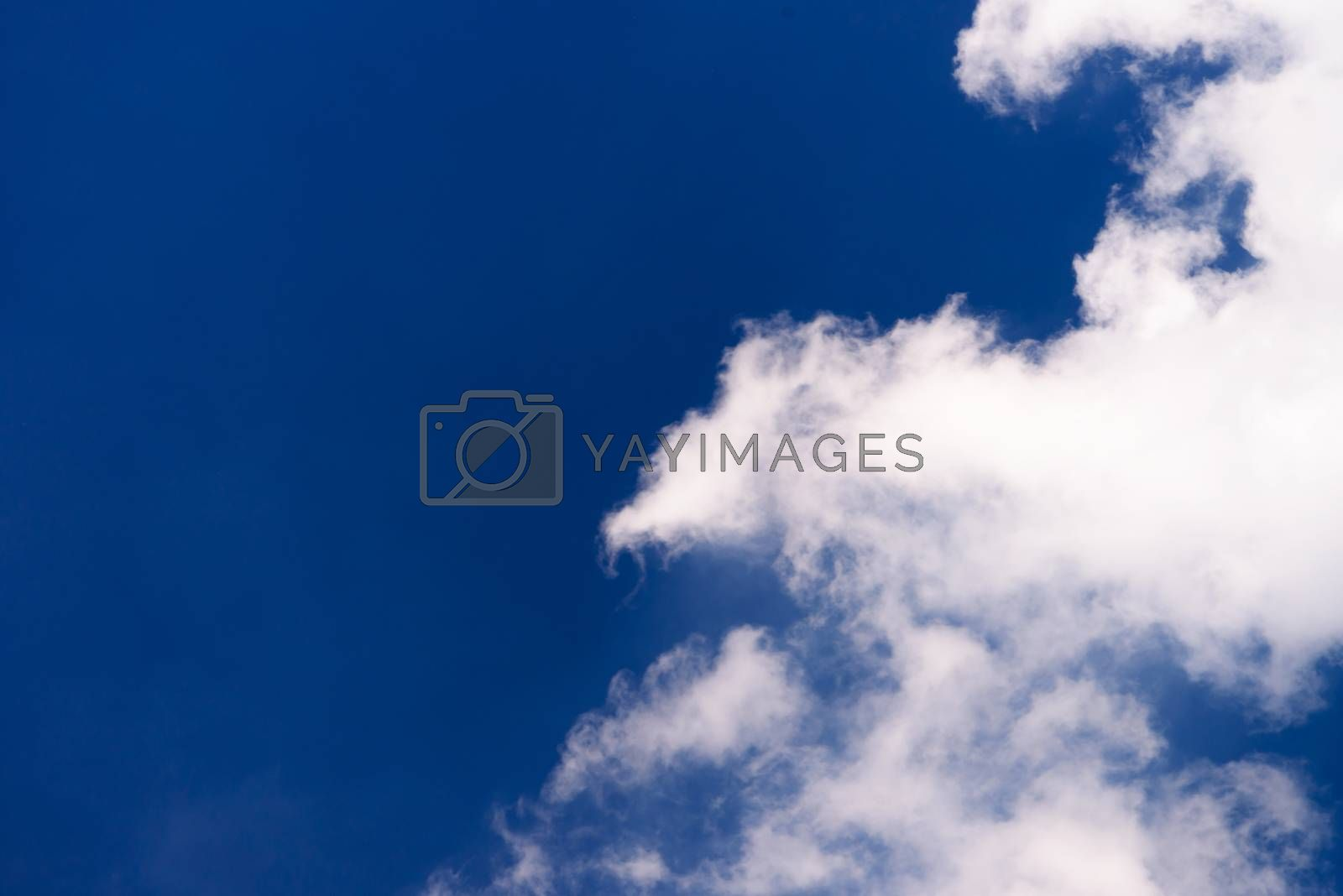 blue sky background with tiny clouds by jakgree