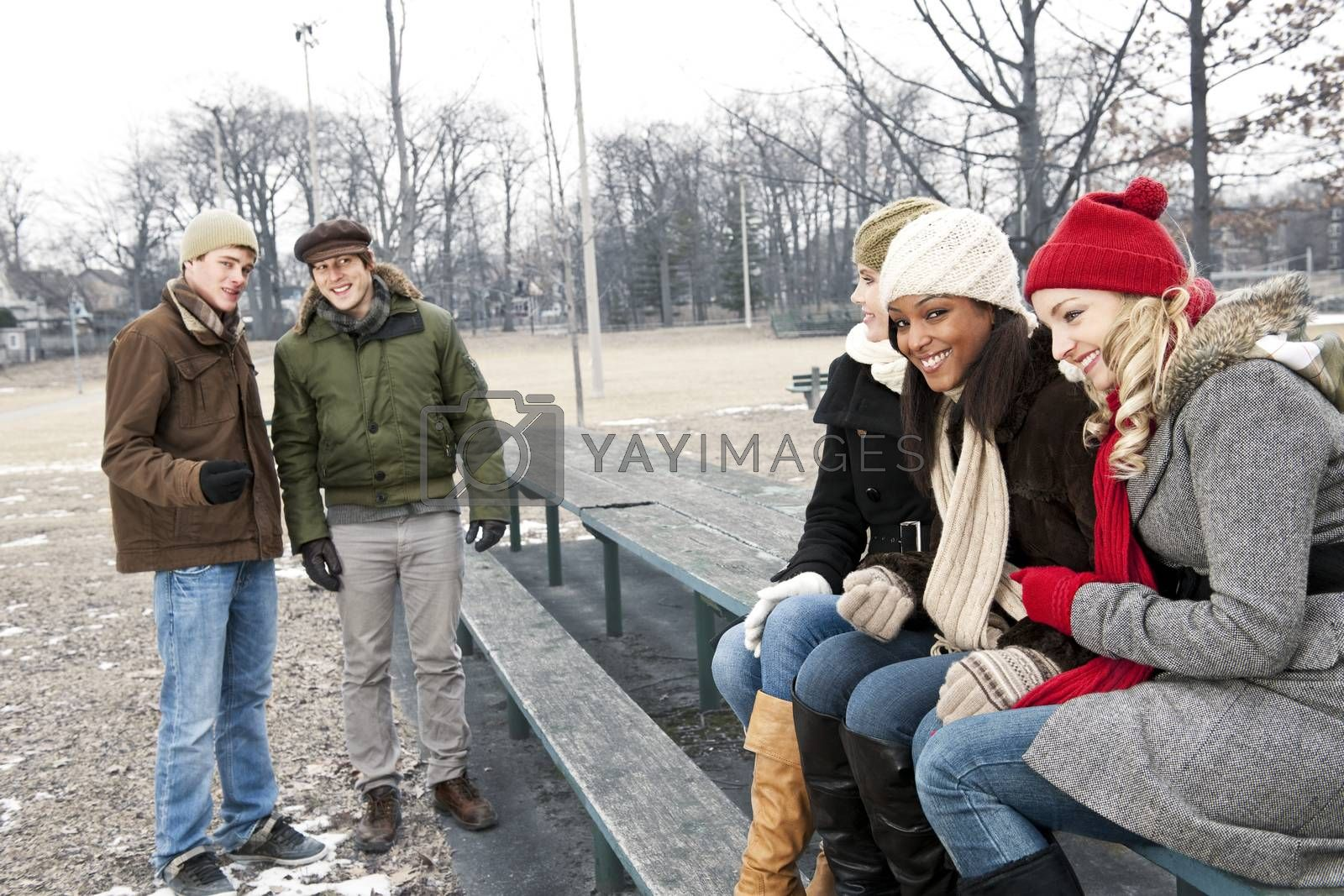 Young friends in winter park by elenathewise