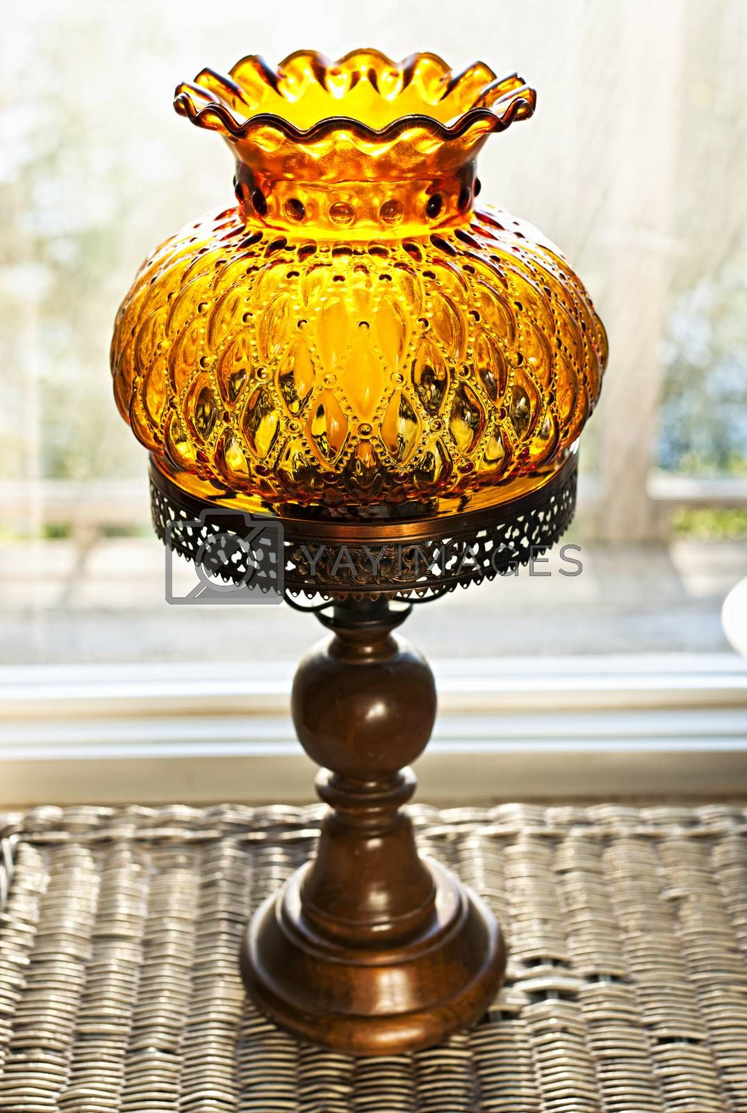 Ornate antique amber glass and wood lamp