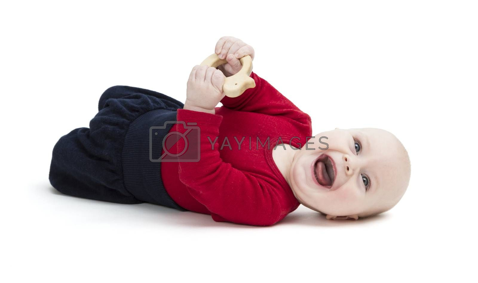 laughing baby in red shirt on floor. isolated on white background