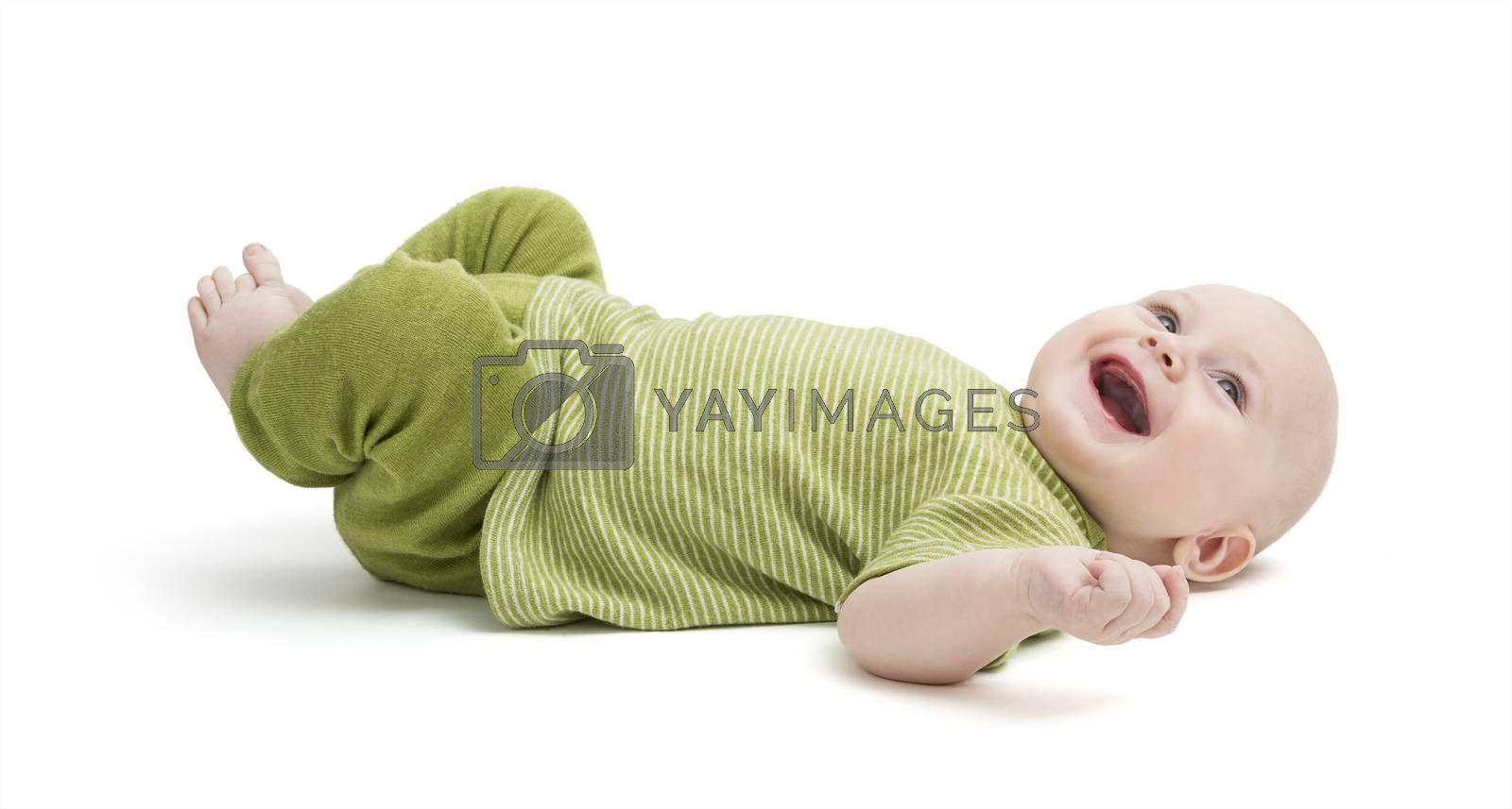 happy, laughing toddler laying on back isolated on white background