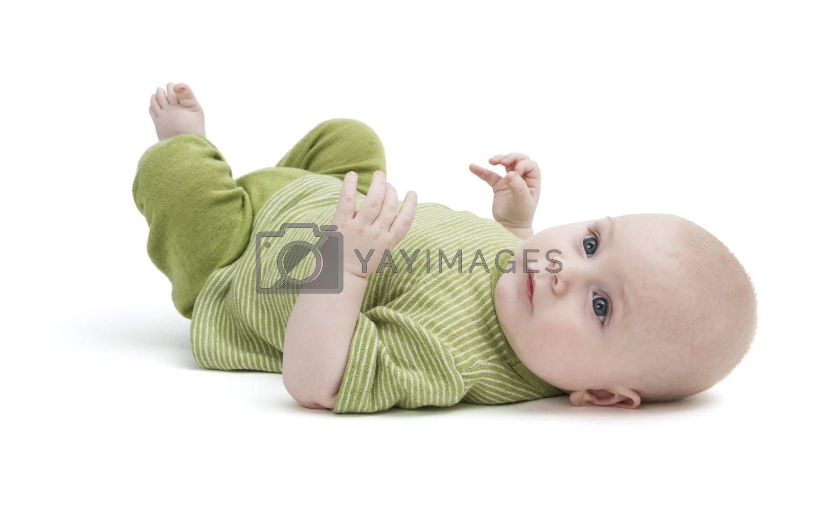 toddler in green clothing laying on back in white background