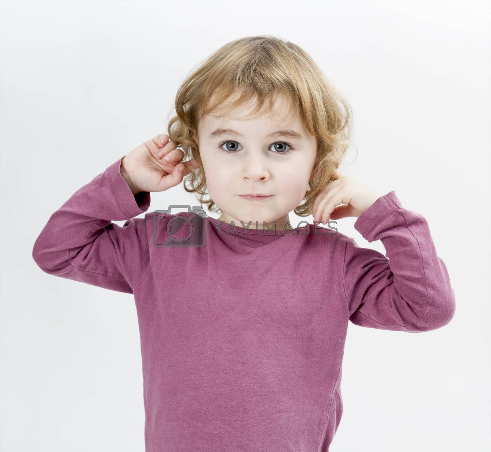 young child with finger in ears isolated on white background